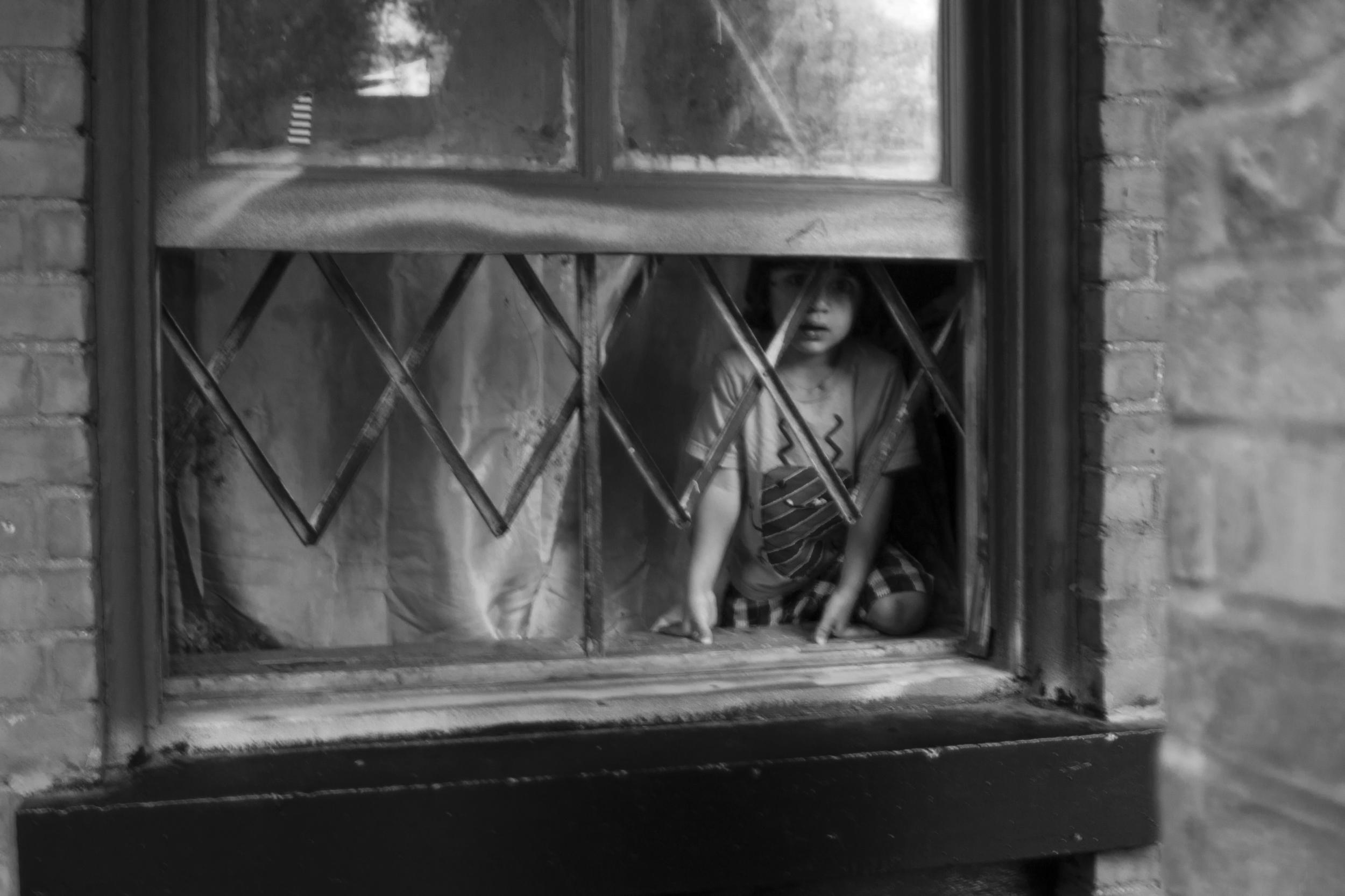kid_in_window.jpg