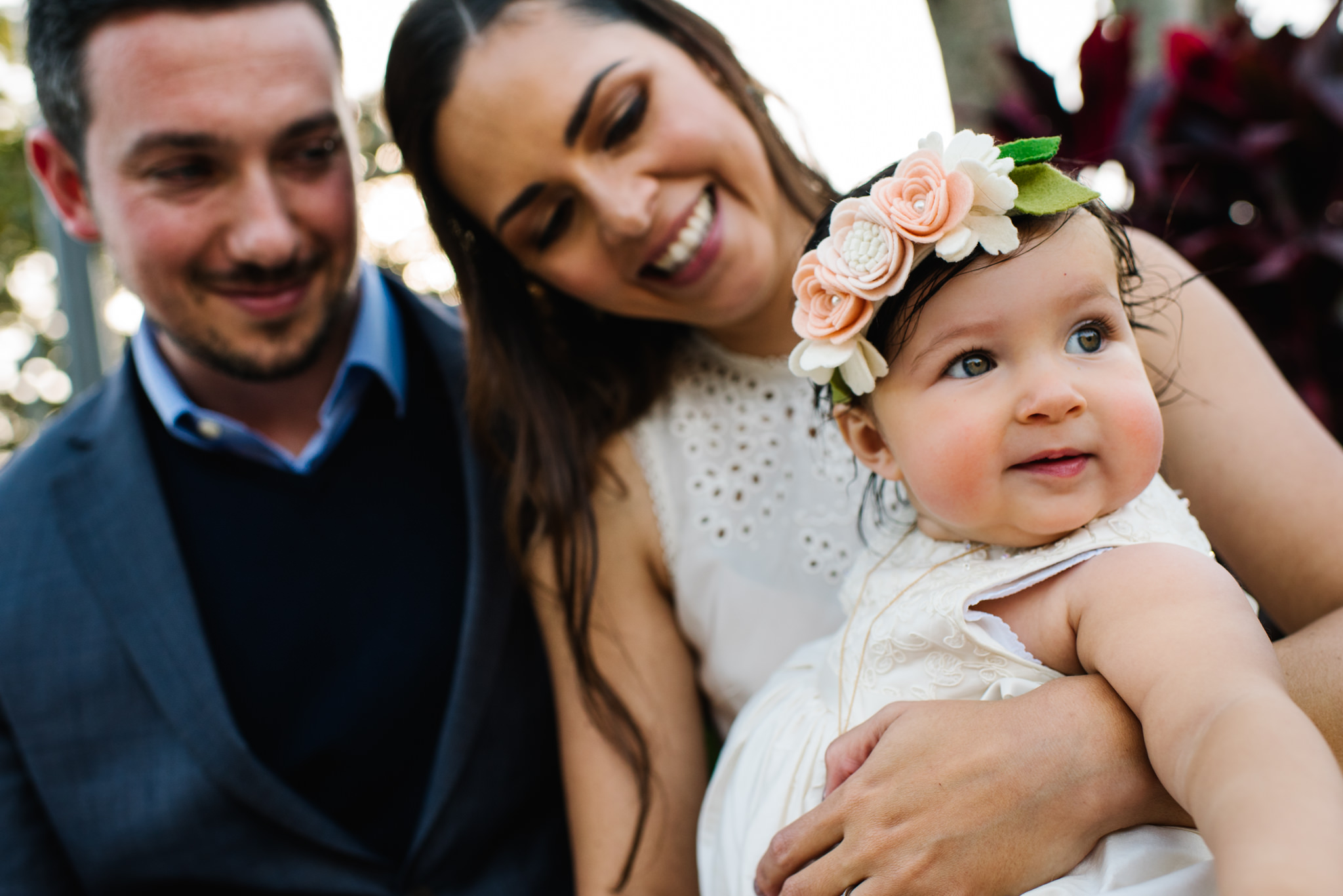 Outdoor family photo at christening reception