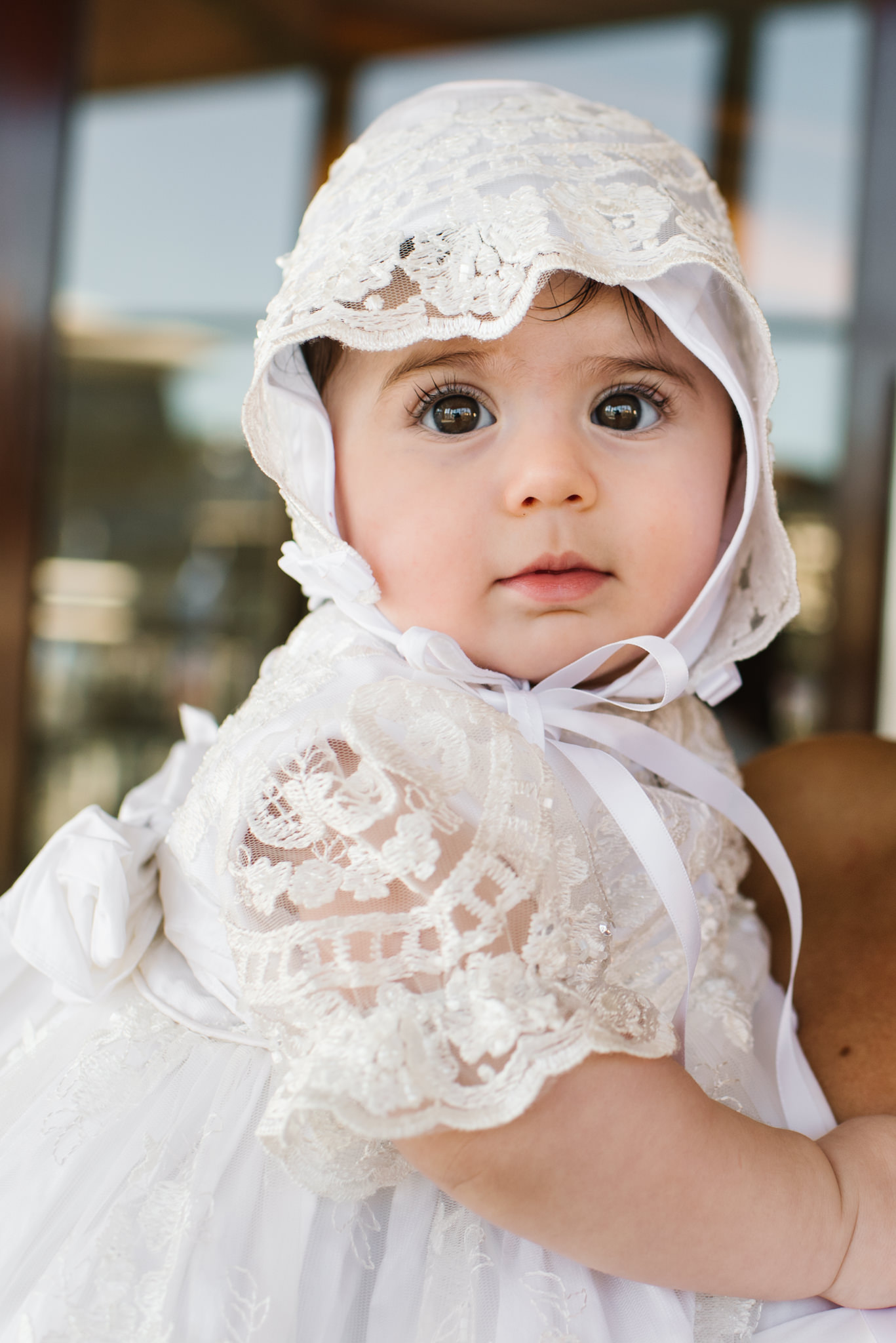 Baby in christening gown and bonnet