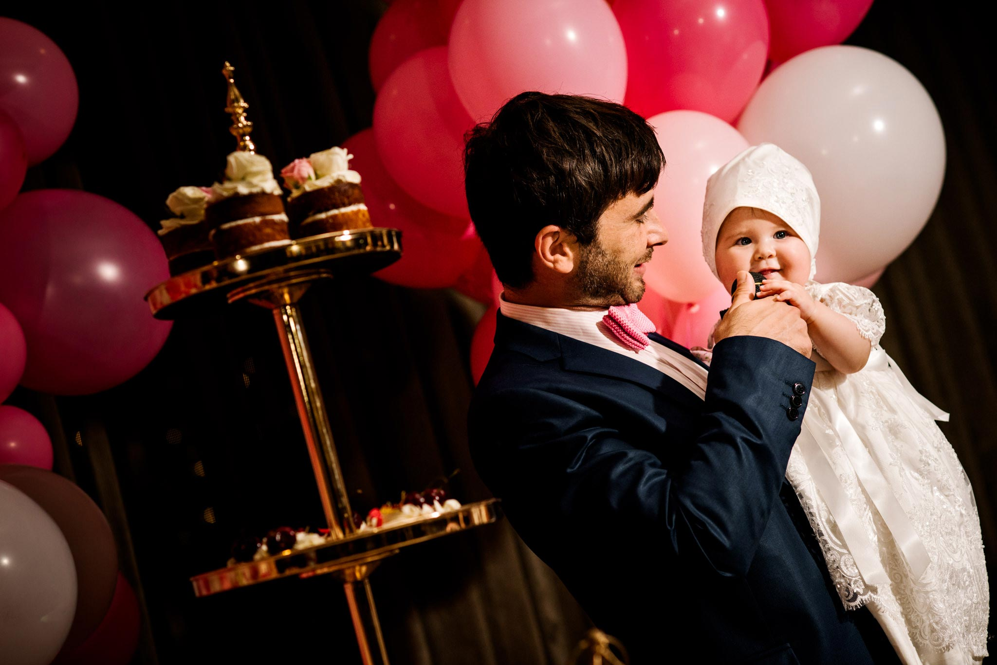 Godfather and baby during christening speeches