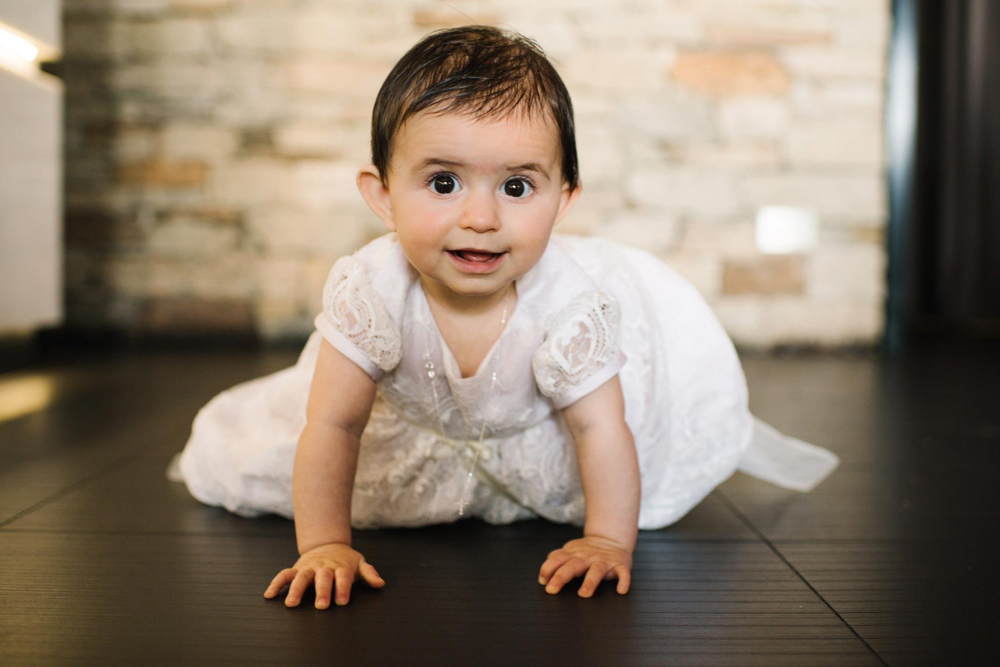 Baby girl enjoying christening party at Bianco Sydney