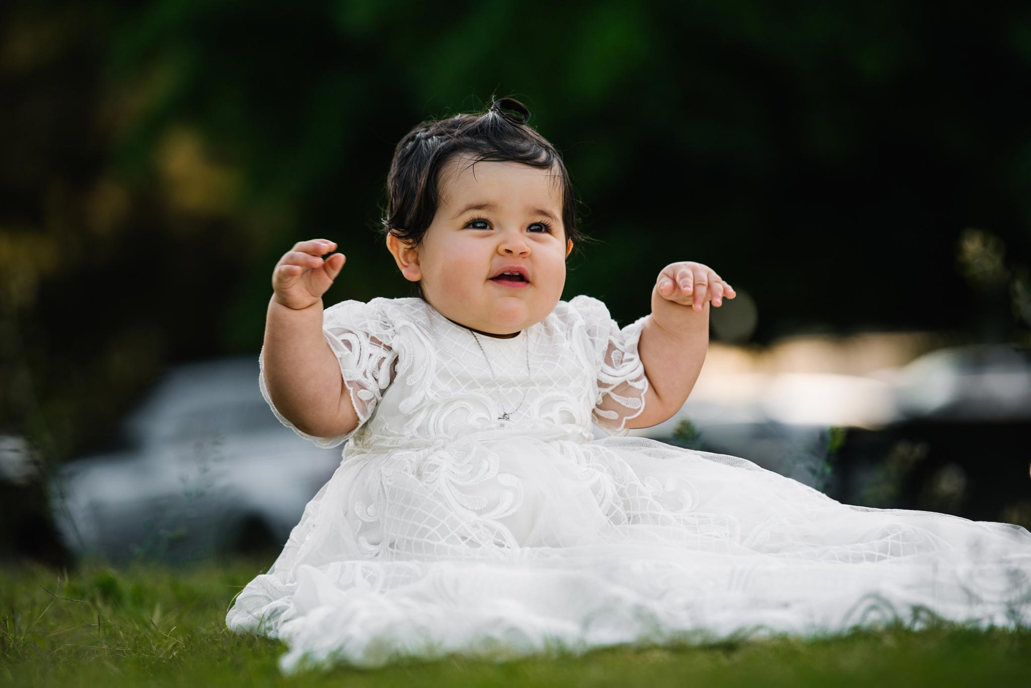 Cute baby in christening gown at Oliveto Ristorante