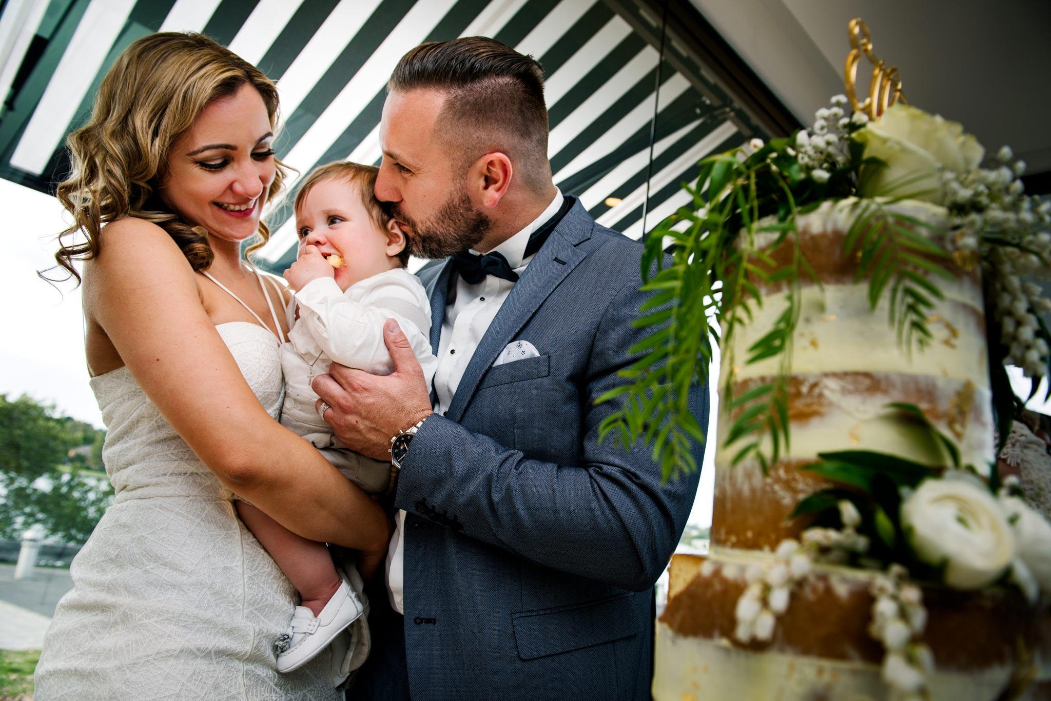 Baby eats christening cake at Oliveto reception