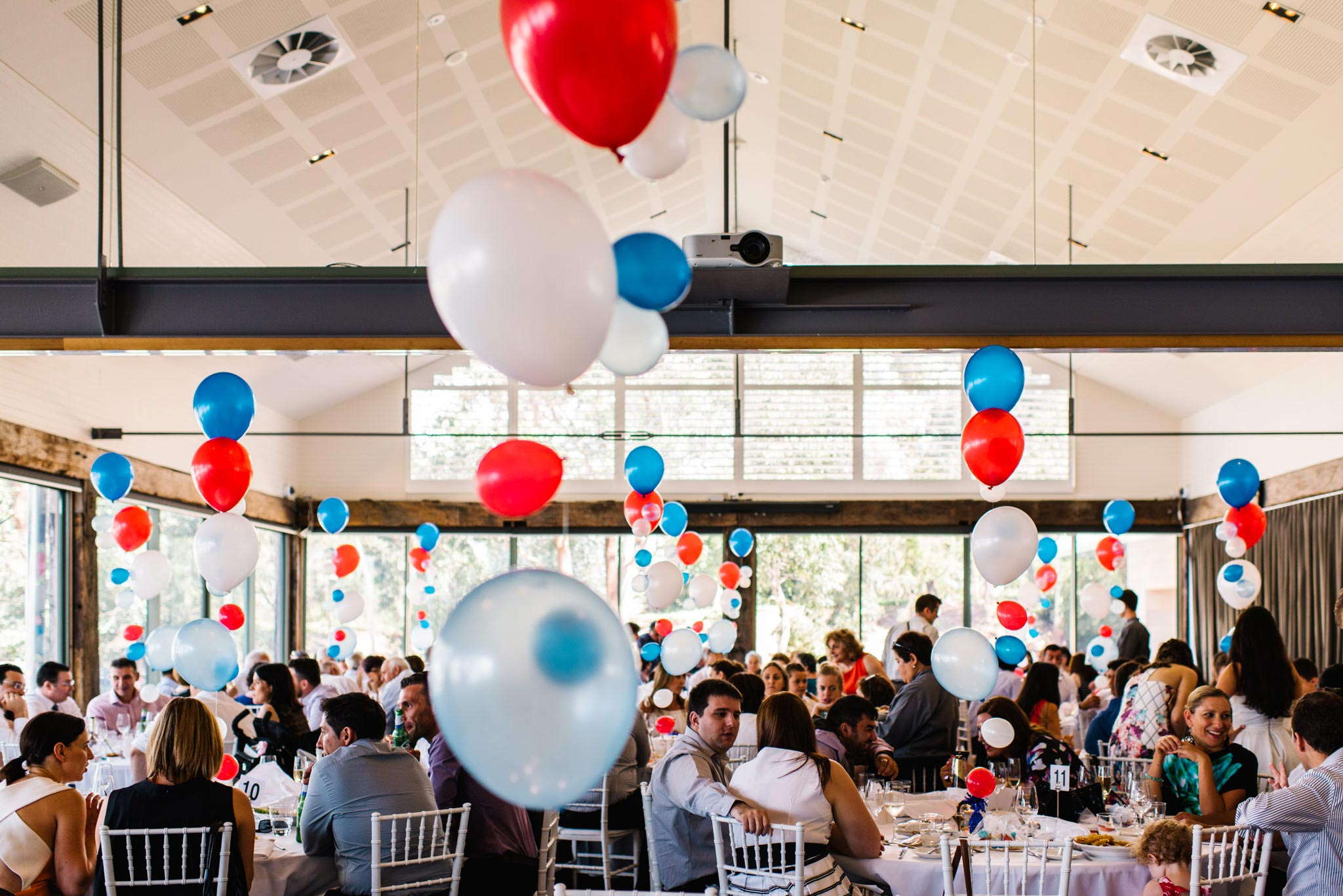 Blue, red and white helium balloons at Deckhouse christening