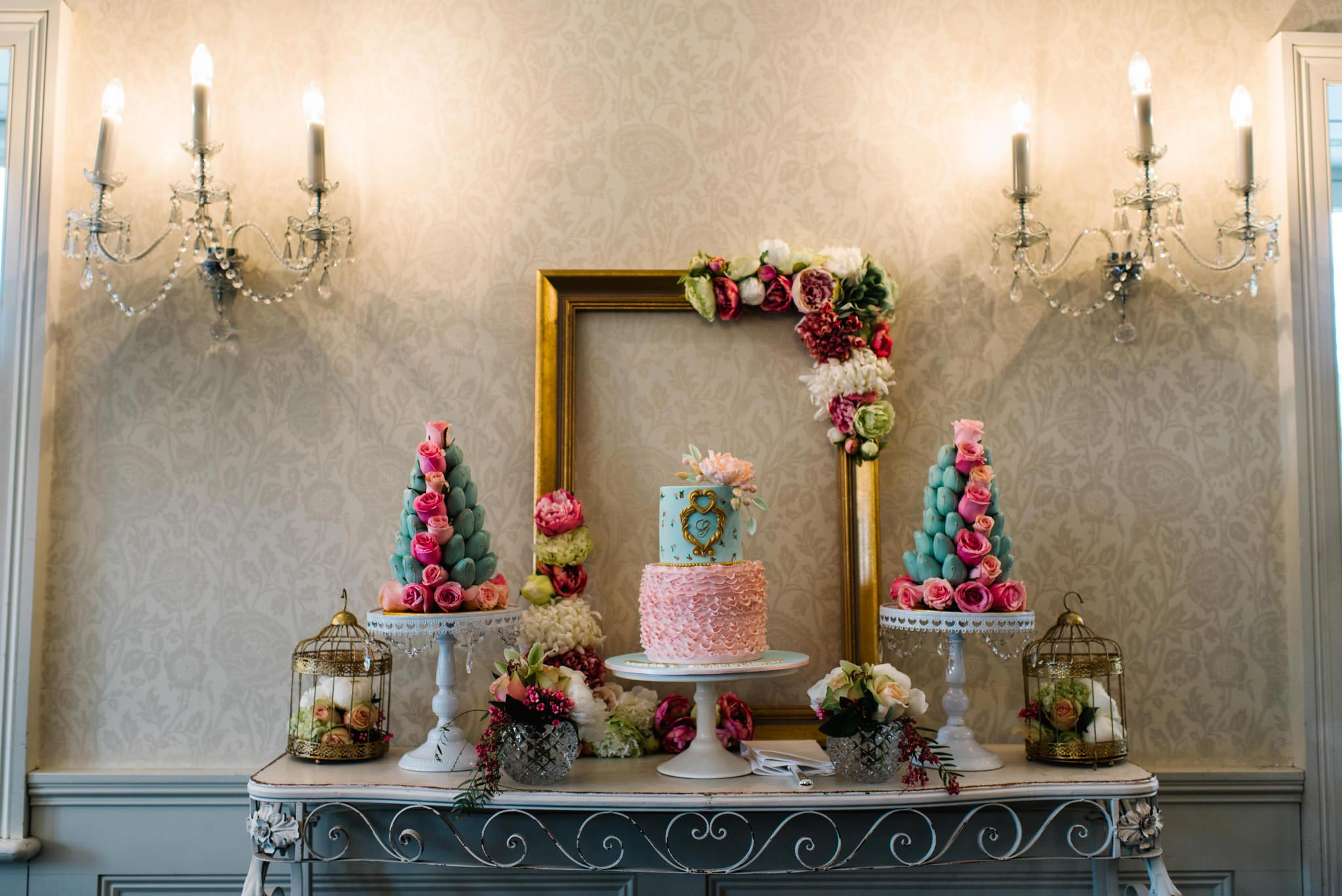 Cake table and decorative wall sconces at Dunbar House
