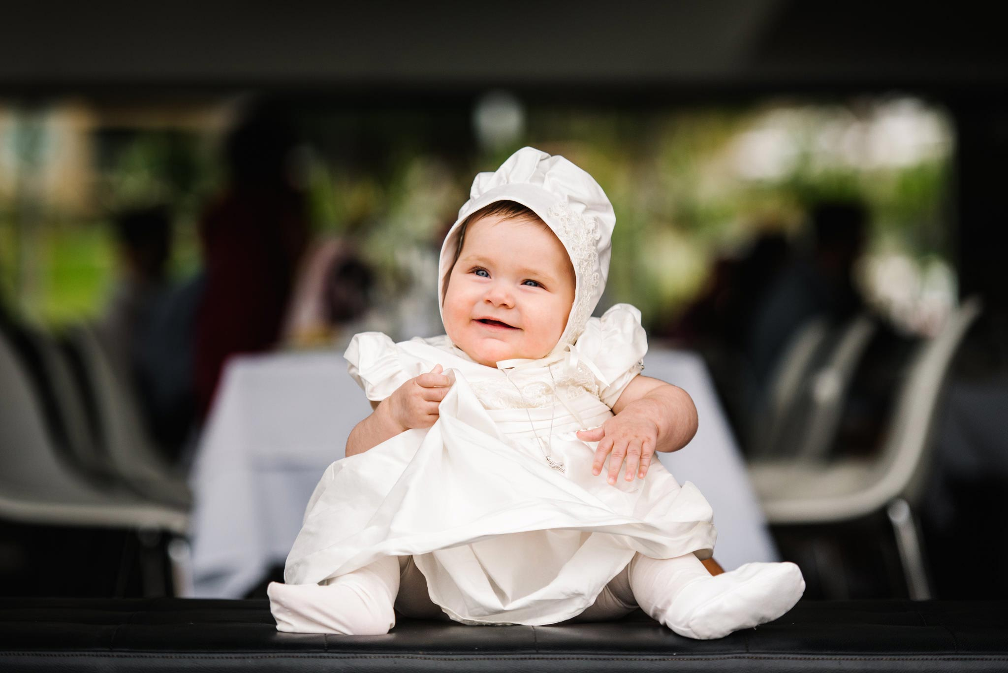 Baby in christening gown and bonnet at Ecco Drummoyne
