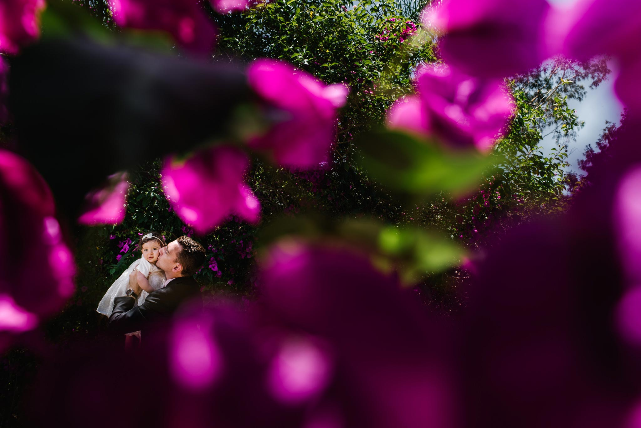 Father and daughter in gardens at Oatlands House christening venue