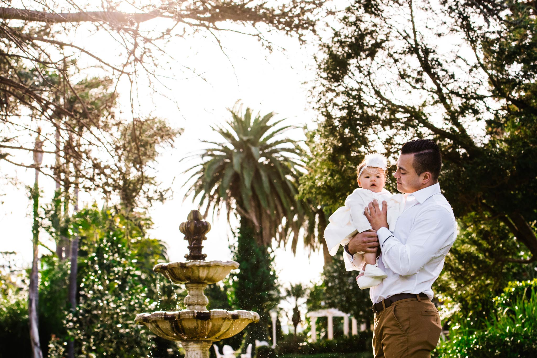 Godfather and baby in front of fountain at Oatlands House