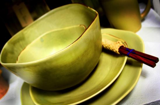 Vance Kitira green bowls on shelf with chopsticks