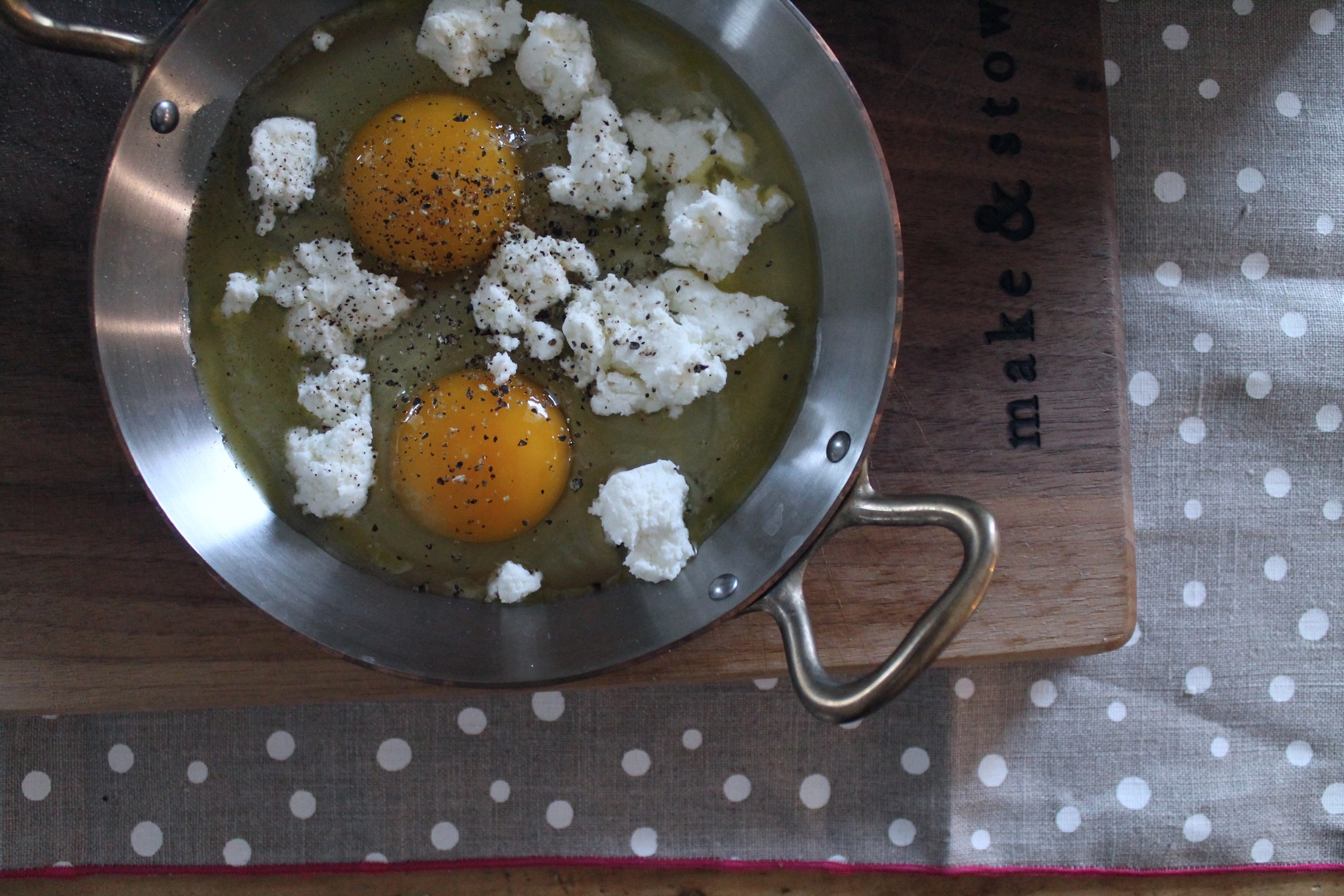 Baked Eggs with Chevre + Cilantro Chutney | www.hungryinlove.com