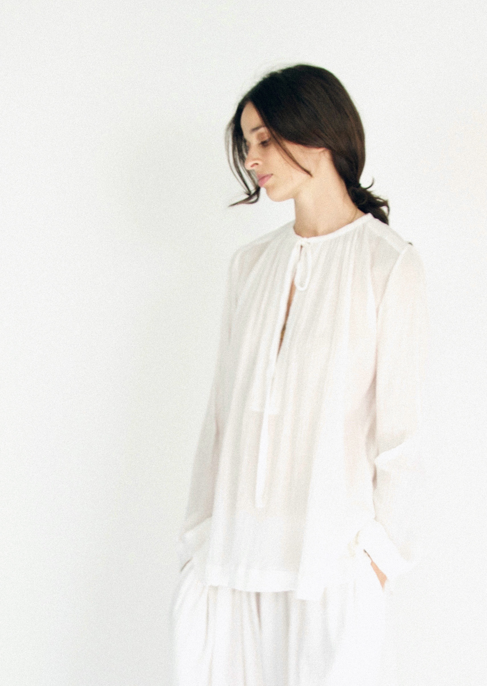 Narelle wears the Tie Neck Blouse