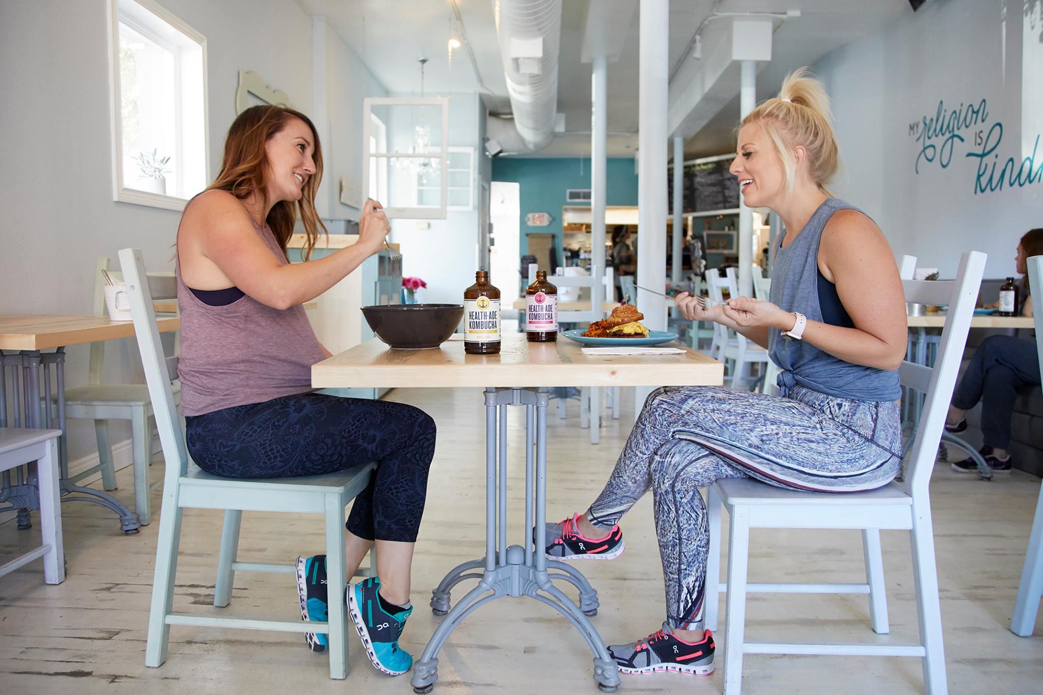 Alex and Cortney eating at Just Be Kitchen Denver bRUNch