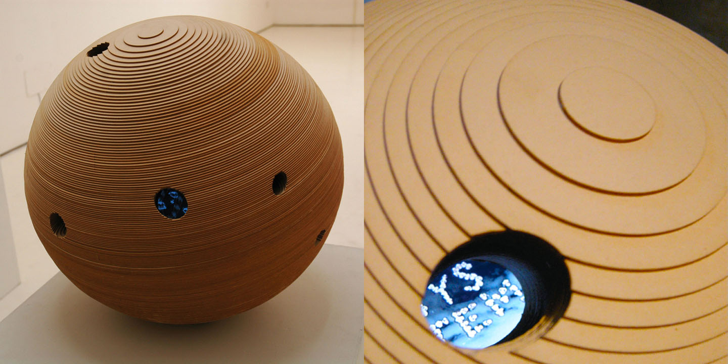 Miniverse 1 , 2008 Layered wooden sphere  45 cm / 18 inches diameter.  5 video screens embedded, 10 synchronized videos, 2.30min each.