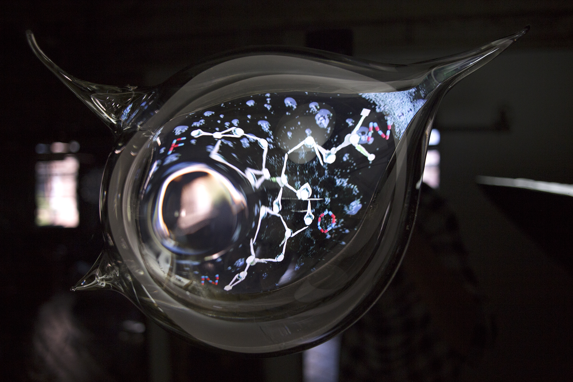 HOW DO SHADOWS ENTER THE MIND?  2017  Multi-channel video, 8:15 minutes, looped hand-blown glass sculpture, video screen embedded in black acrylic On/Off switch and sound control 15 x 20 x 6in. /38 x 51 x 15 cm Edition Unique