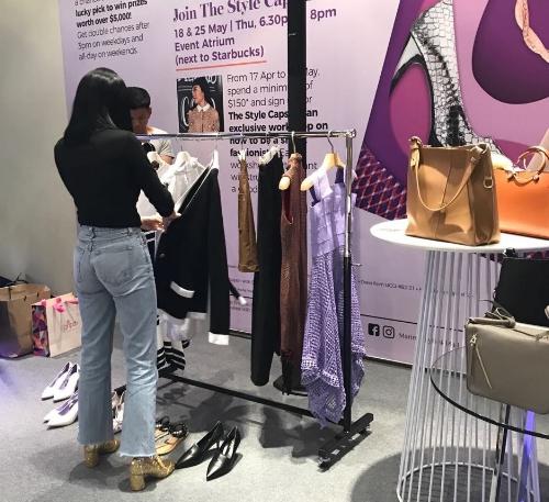 Savina Chai, style influencer, doing final checks on the selected outfits.