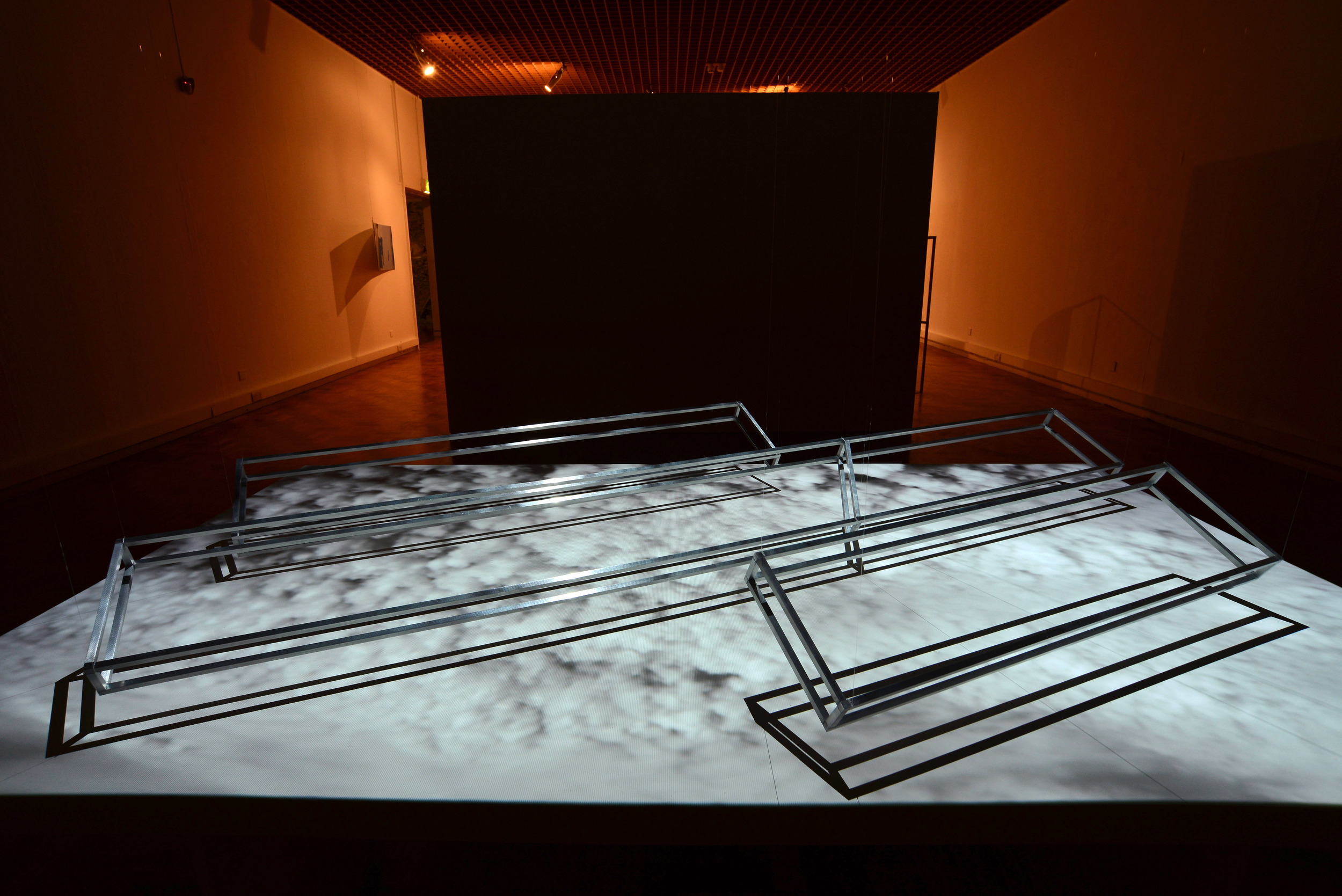 Air-toAir (Pitched Formation) , 2015, aluminium frames, screen and moving image projection.  Installation view.