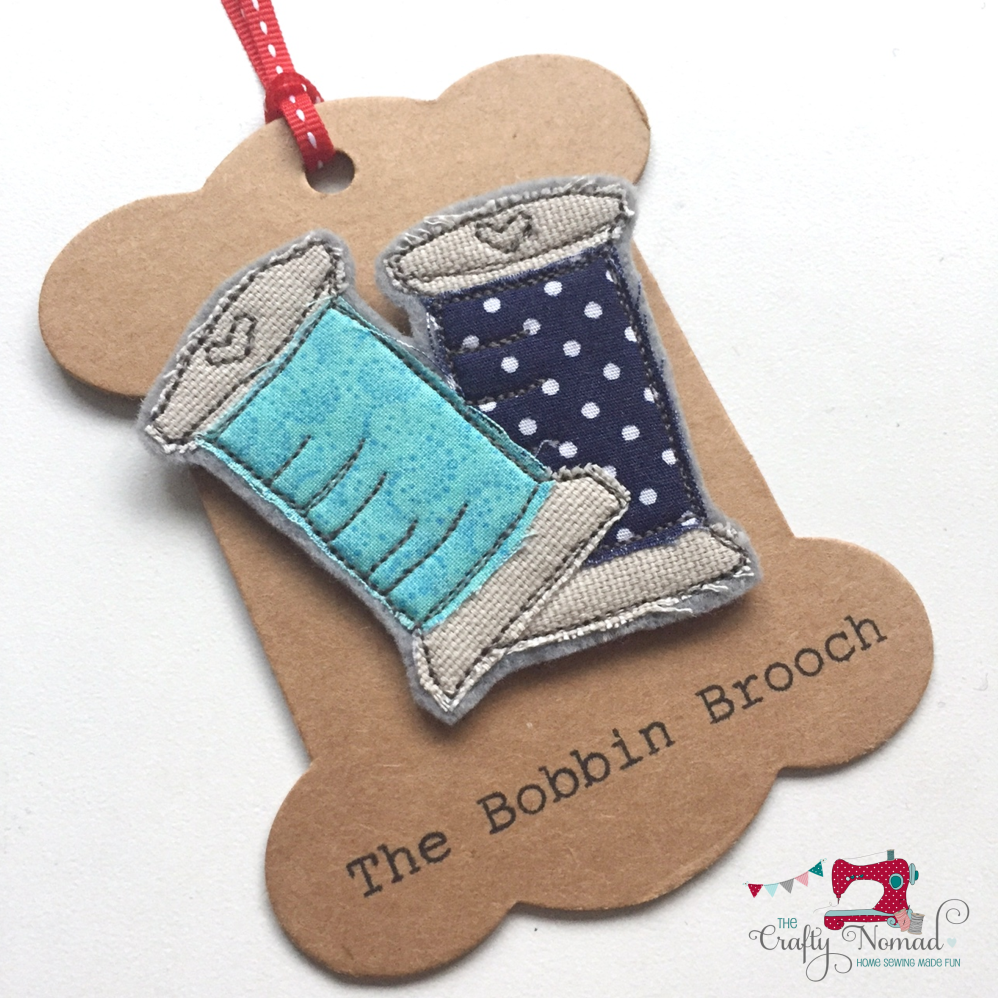 Double Blue Bobbin Brooch The Crafty Nomad.png