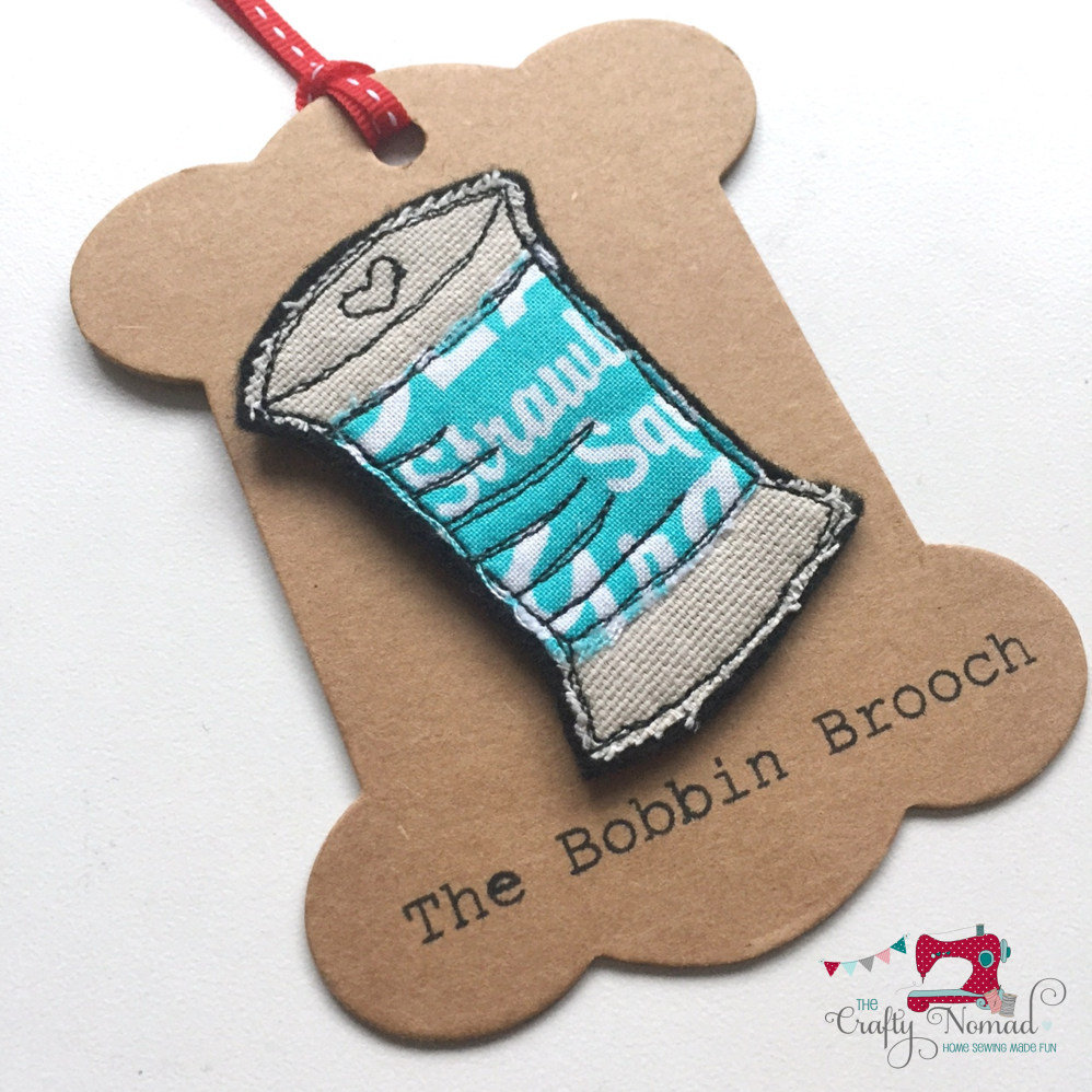 Turquoise words Bobbin Brooch The Crafty Nomad.png