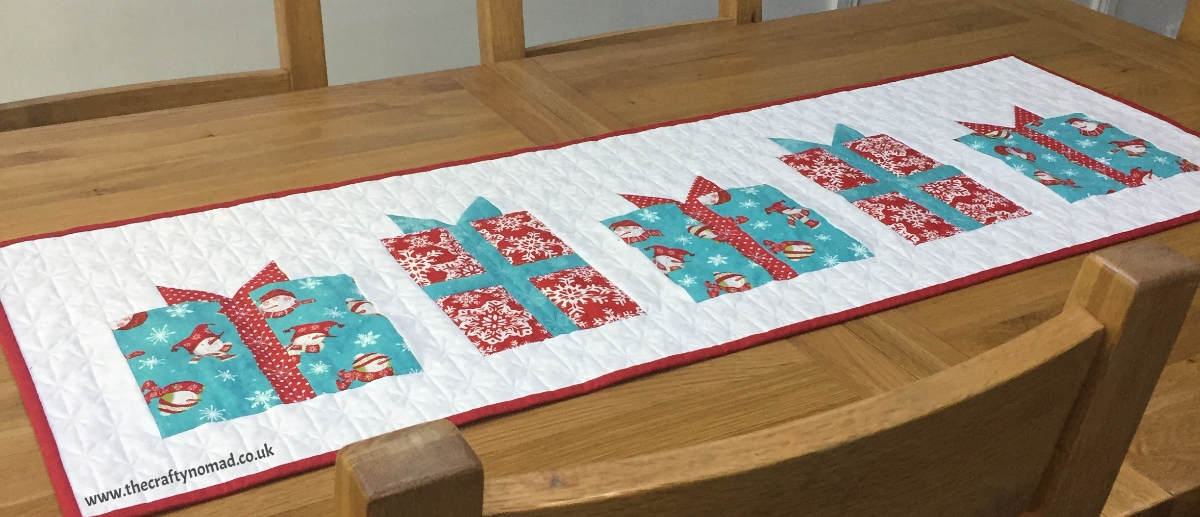 Gifts Galore Table Runner Pattern by The Crafty Nomad
