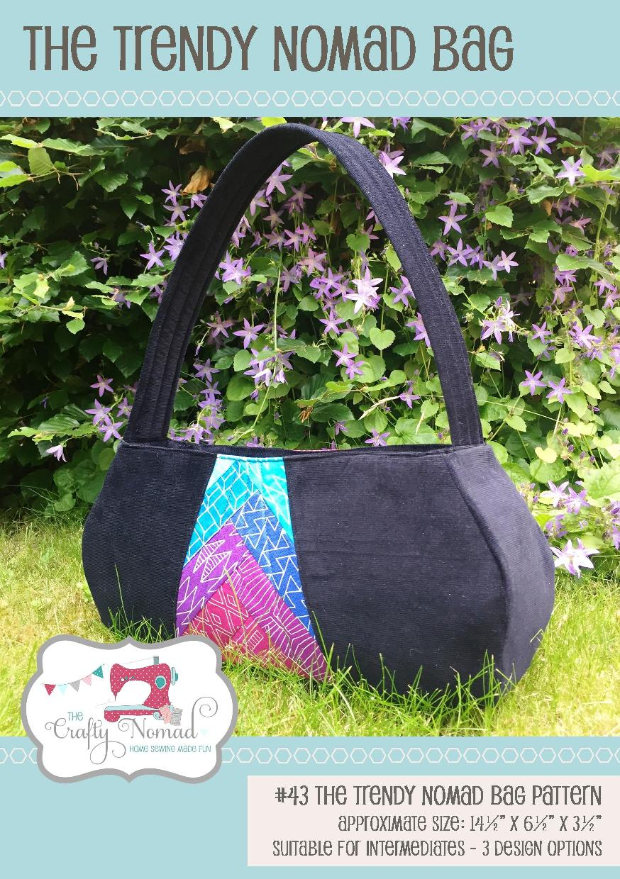 """The Trendy Nomad Bag - is the perfect size to fit all your necessities in. The handle length means it nestles comfortably under your arm. It features a recessed zip which can be a handy skill to learn. The pattern gives you the choice of fusible fleece or Bosal form to give the bag structure. Add the optional patchwork front panel, use one single fabric in the central panel or leave it out altogether and just use one fabric for the outer. The choice is all yours!The bag finishes up at about 14½"""" x 6½"""" x 3½""""."""