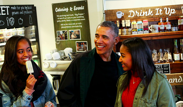 President Obama, Sasha, and Malia getting pops on Saturday. courtesy of White House Press Pool