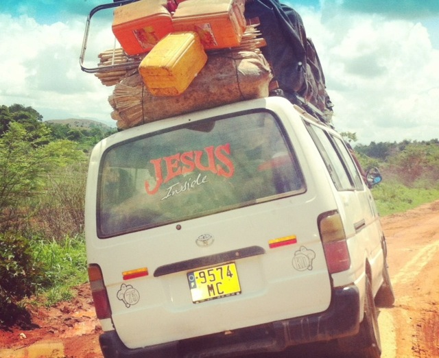 """En route to the village of Mandritsara on a """"taxi-brousse"""", the common form of public transportation in Madagascar. The Malagasy will fit an impressive number of people and belongings in one taxi-brousse van. Elbow room is non-existent. Photograph by Alizé Carrère"""