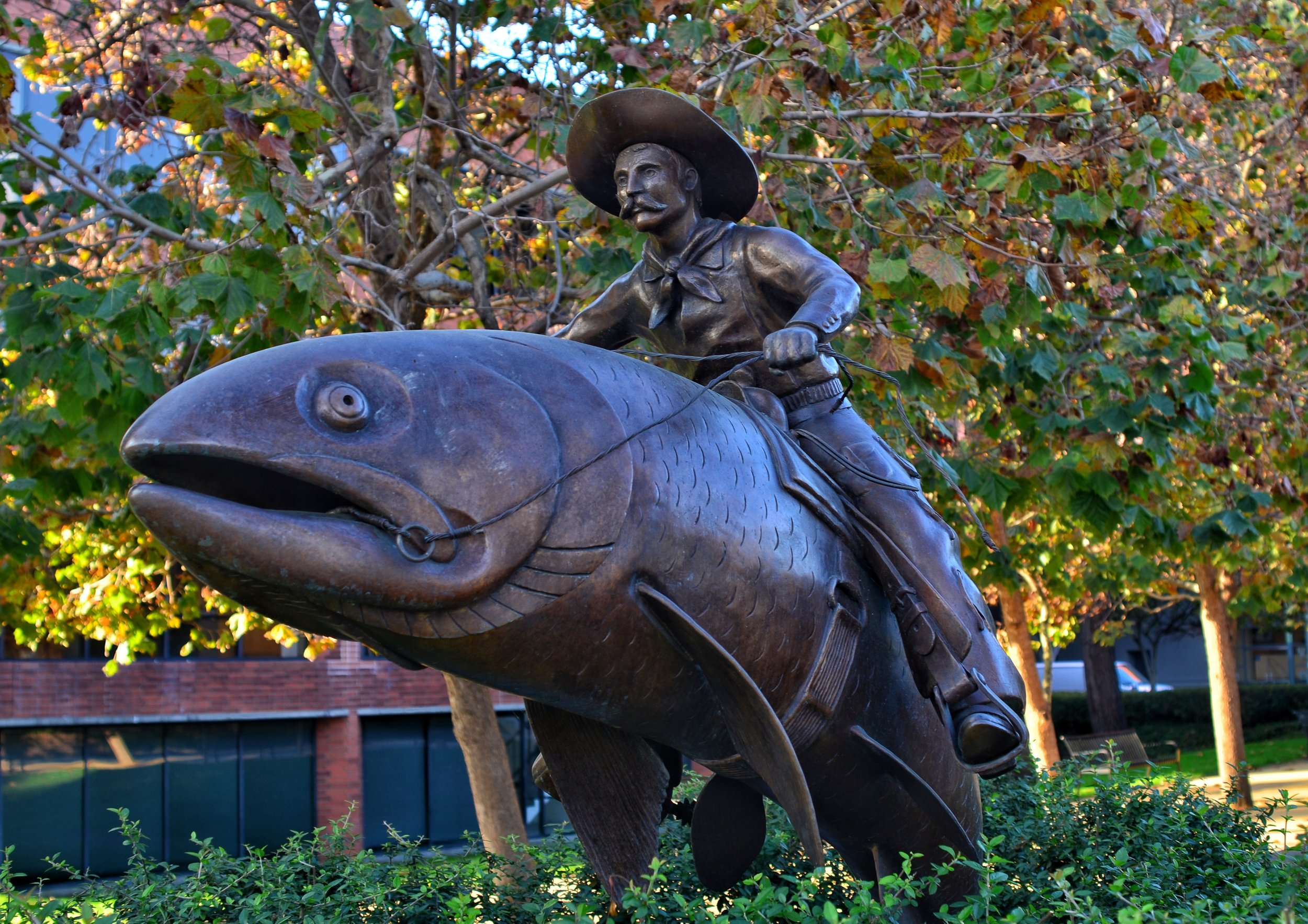 """ Cowboy on a fish"" statue outside Hillstone Steakhouse"