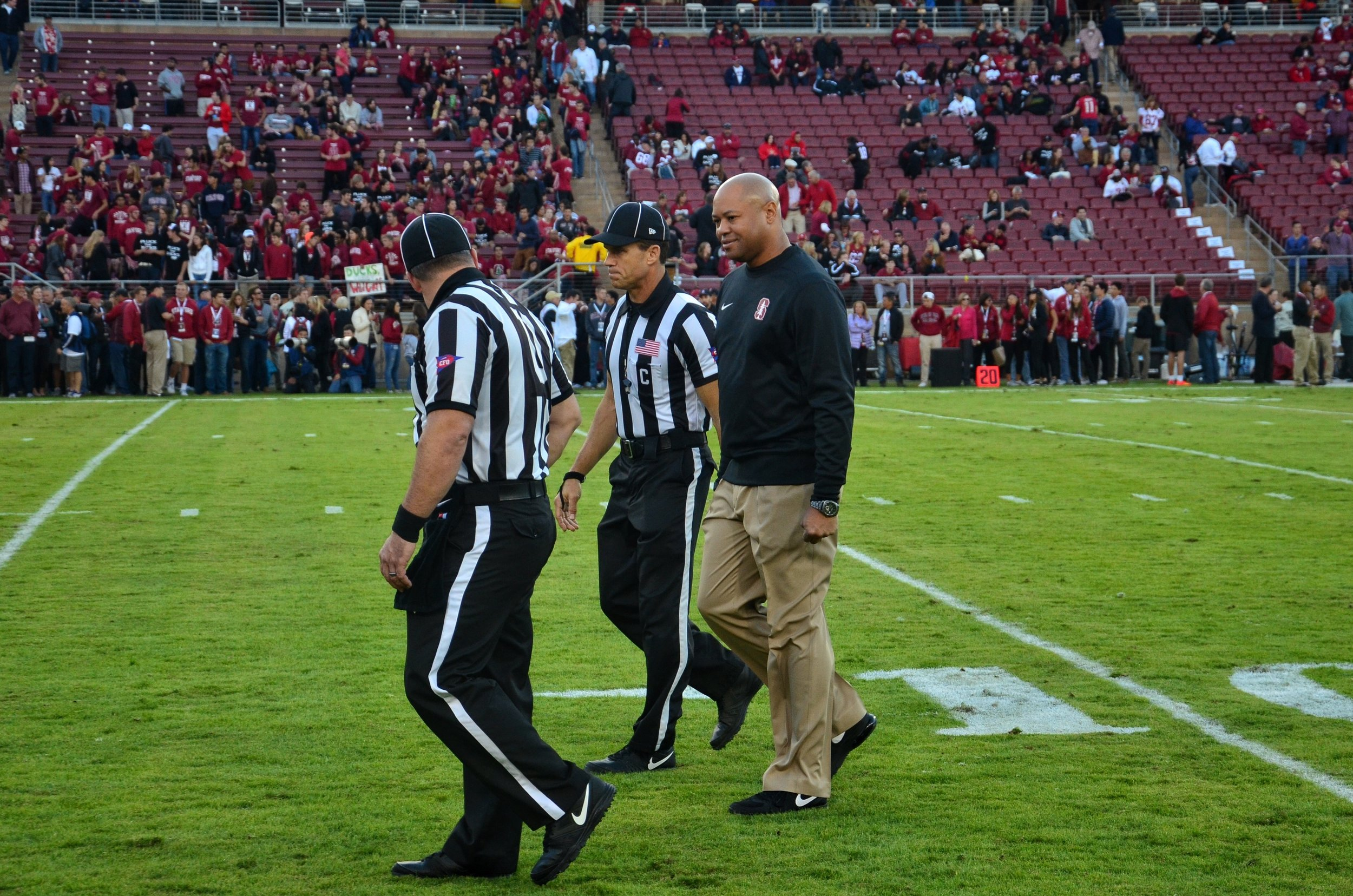Stanford head coach David Shaw talks to the officials prior to the game.