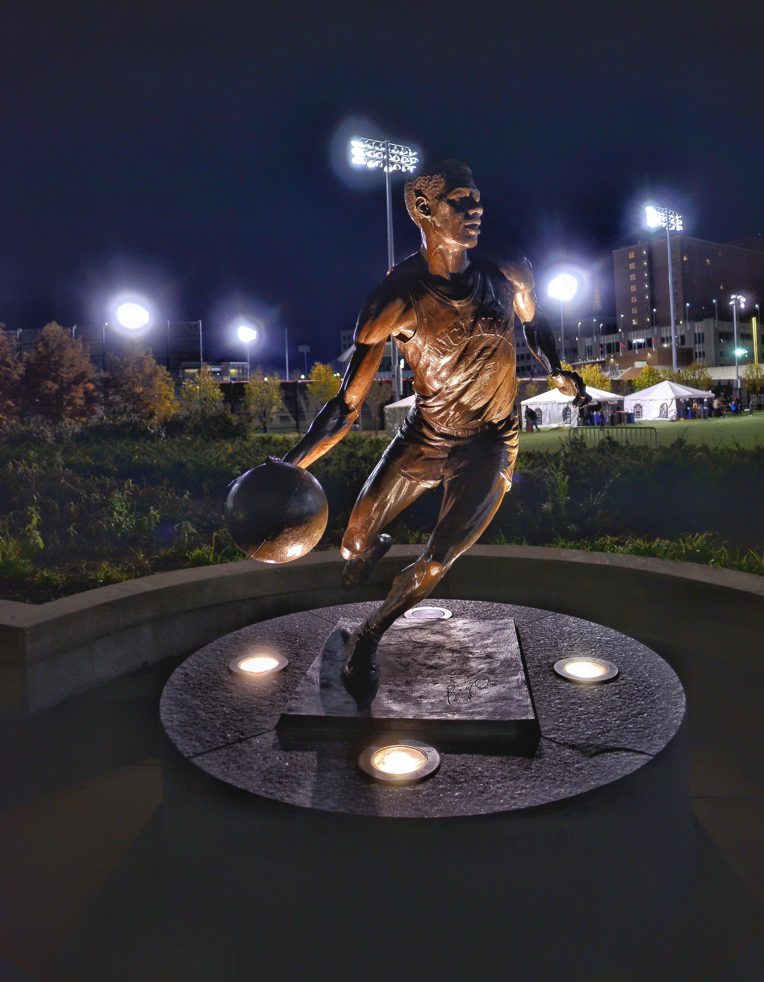 Oscar Robertson statue outside of the Lindner building. Robertson, one of the greatest basketball players of all time at any level played at Cincinnati from 1957 through 1960 and averaged 34 points 15 rebounds and 7 assists per game.