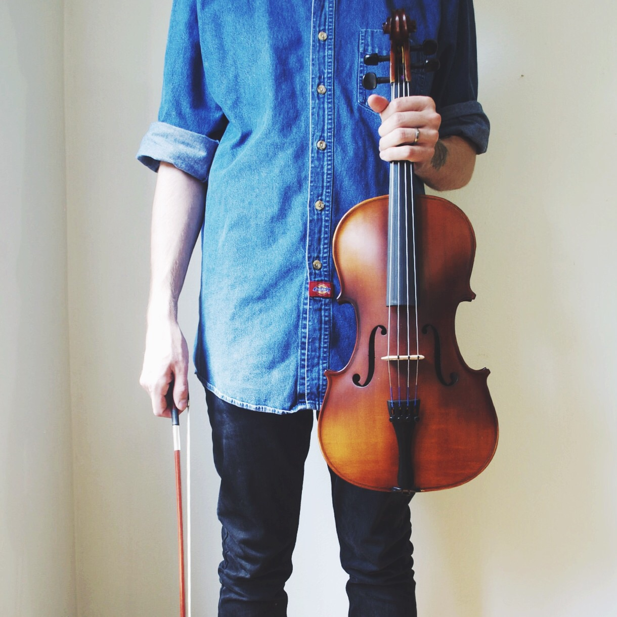 Collin holding one of his prized possessions: his beloved  viola .
