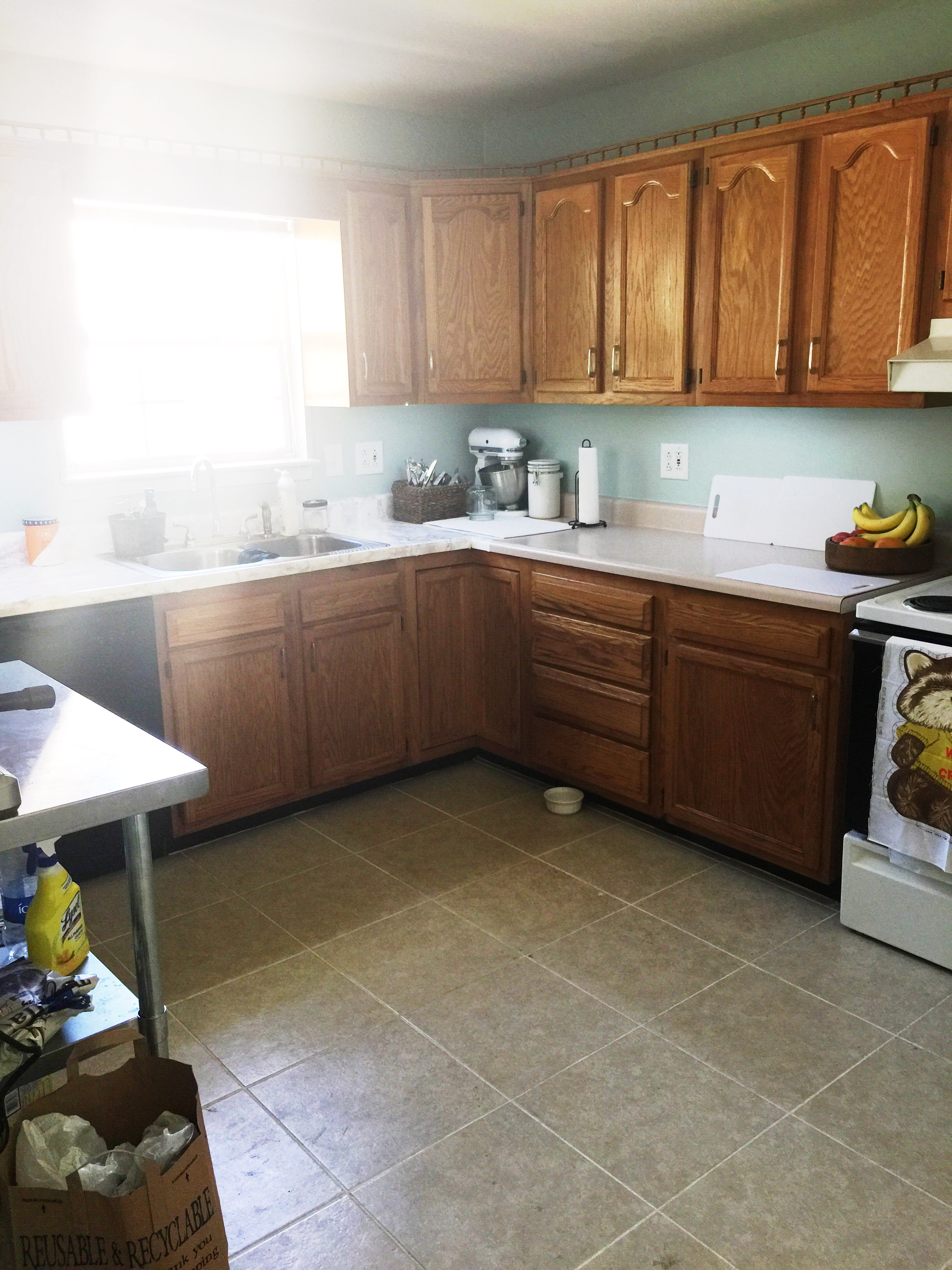 This kitchen is literally my biggest problem. Can't paint the cabinets! I'm already using contact paper for the counters and am not interested in using it for the cabinets as well. I changed the hardware and it helped some. Any ideas?!