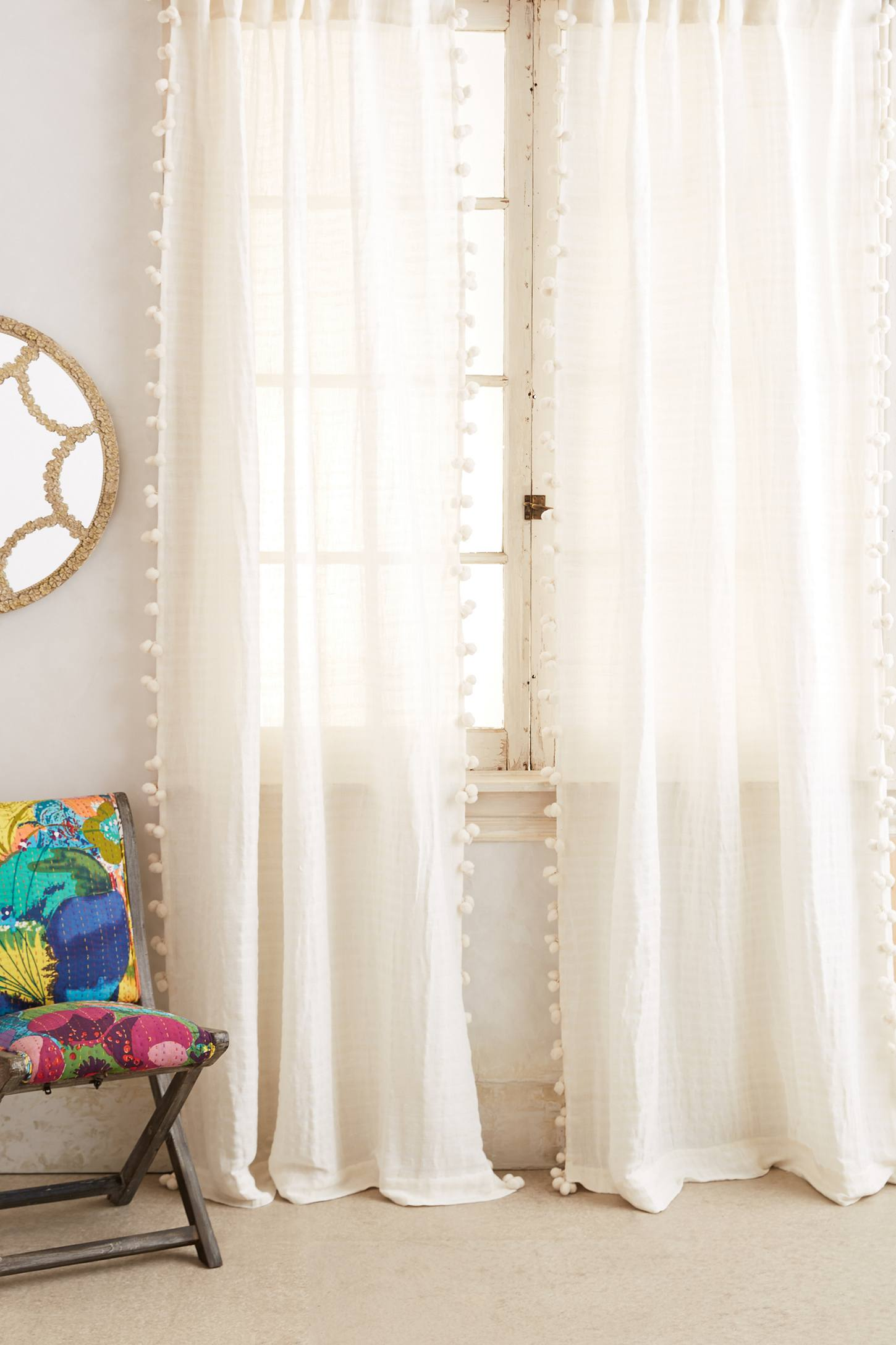 anthropologie.com - At $100 a panel, these can get a little pricey if you're looking to cover more than one window. My DIY version cost me less than $50 for two panels and a curtain rod!