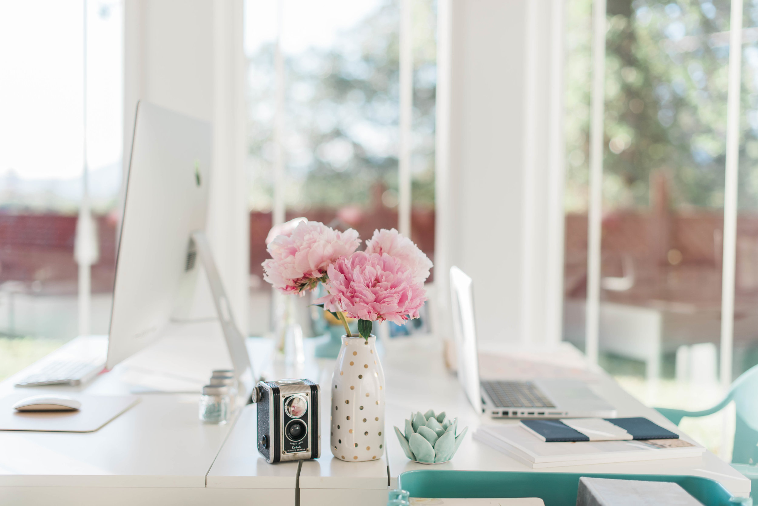 "This photographer's must have items...27"" iMac, vintage film camera, bouquet of peonies, Macbook Pro! Come back next month for a more detailed list of what key items I live for in my office and organizational tools that can help anyone design a beautiful and functional space!"