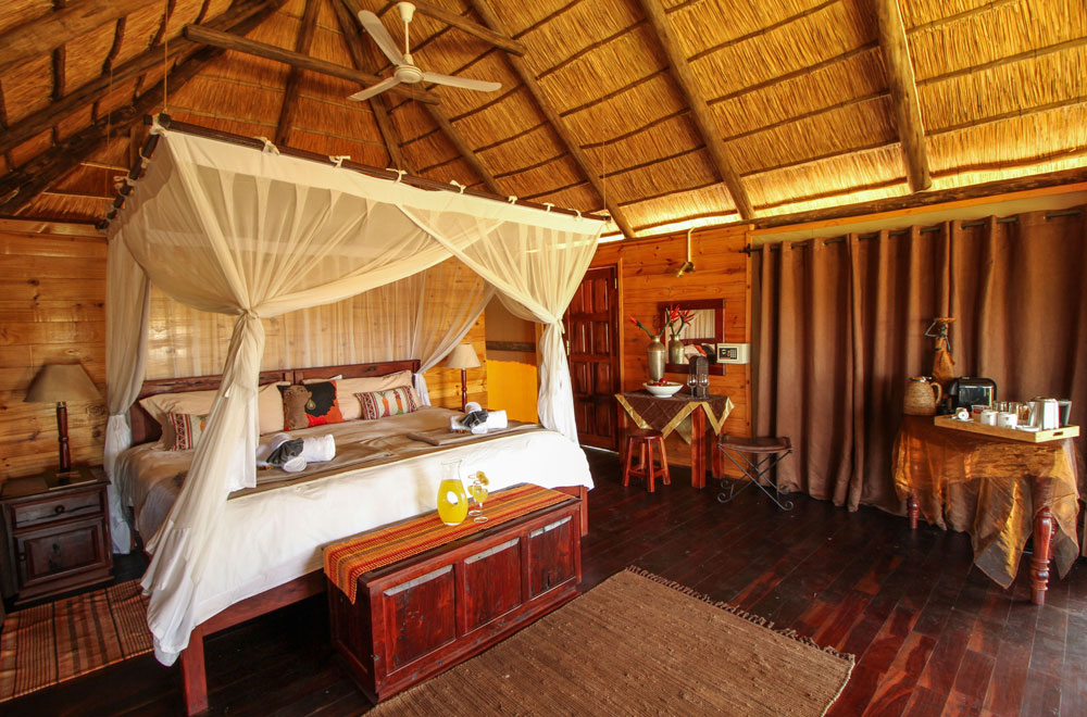 Thatch-roof tent and teak floor at Nehimba Lodge