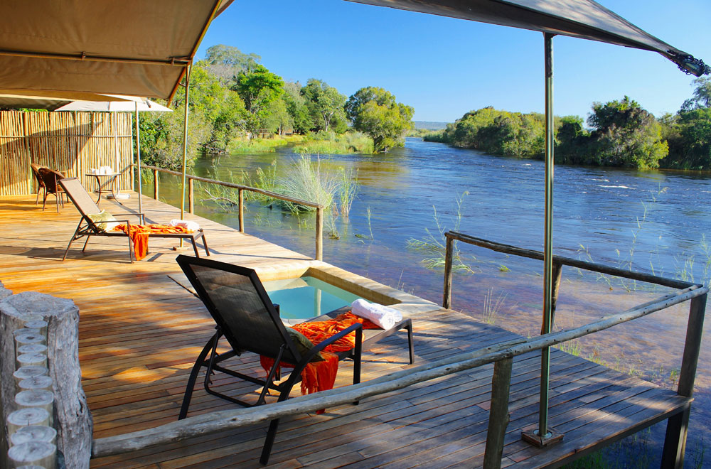 Private deck and plunge pool along the banks of the Zambezi