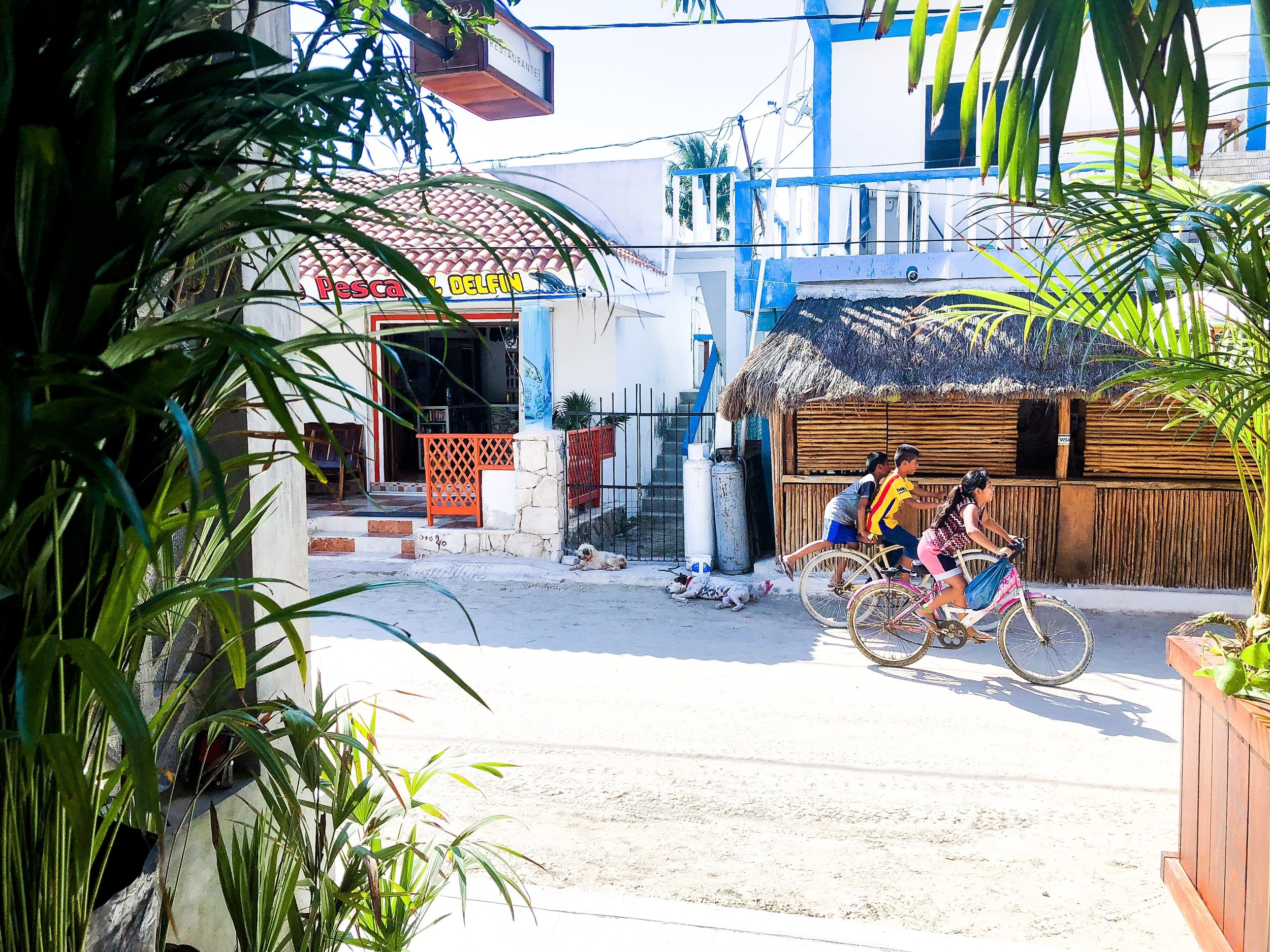 The happiest kiddos and pups lounging in the town - Isla de Holbox, Mexico