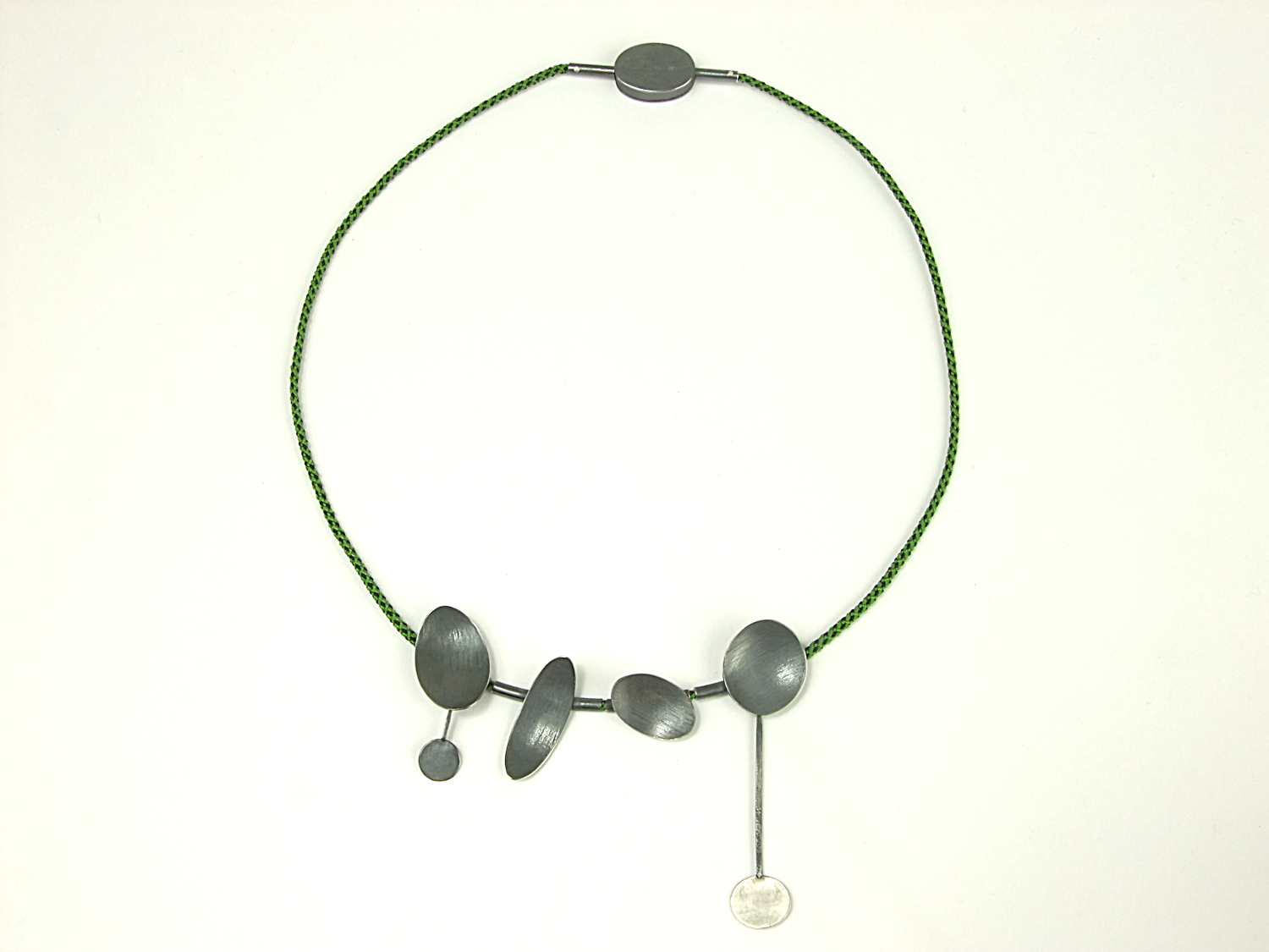 Green & black Kumihimo silk braided necklace with four small, textured, partially oxidised, domed oval pendants and oval clasp. (HBM086)