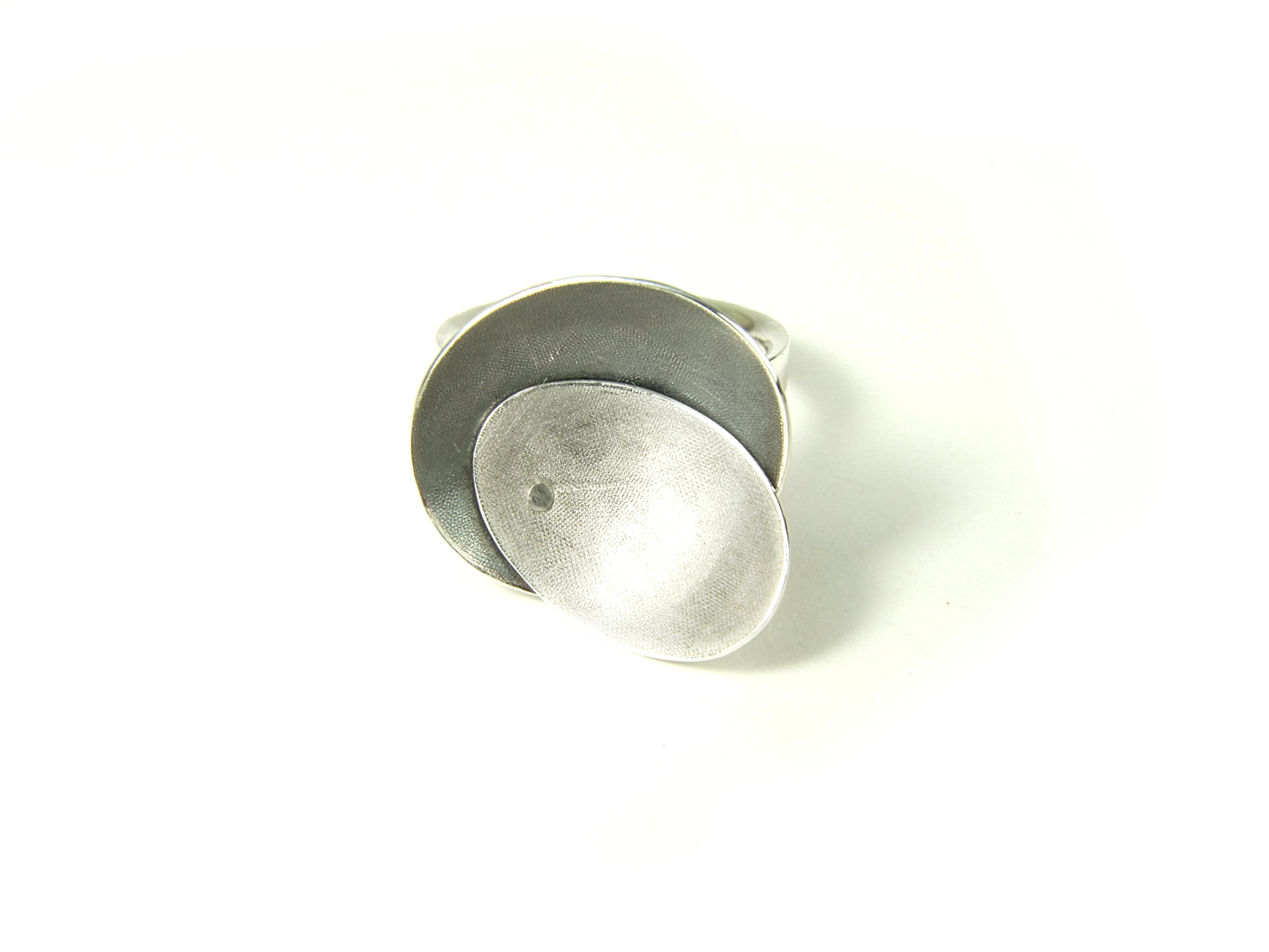 Front view Argentium silver ring with two textured and domed oval top pieces, riveted together & partially oxidised. HBM084A