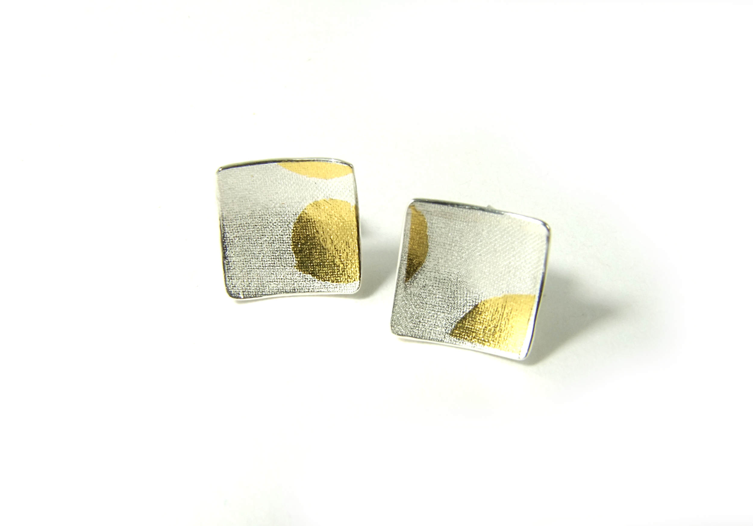 Front view of square, domed and textured Argentium silver ear studs with round Keum-Boo patterns in 22K yellow gold. Size: 10x10 mm (HBM085D)