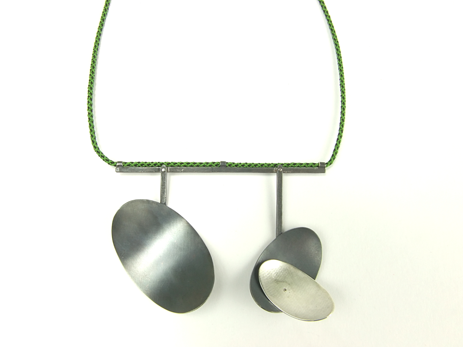 Detail of the oval Argentium silver pendants.