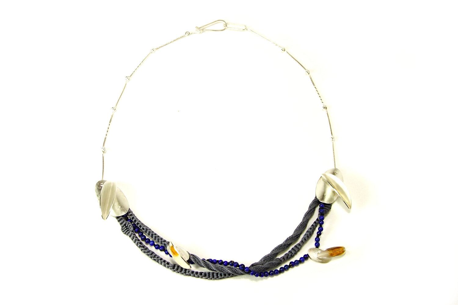 Front view of silver necklace with silk braids, Lapis Lazuli beads.