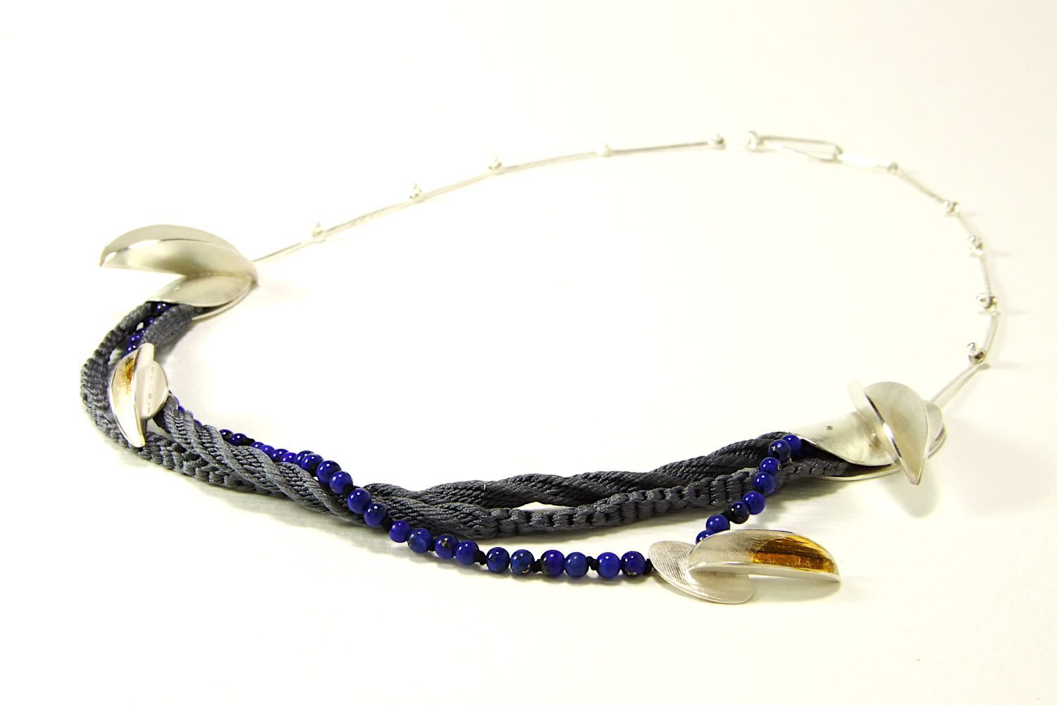 Detailed view of Lapis Lazuli beads and silver pendant with Keum-boo decoration.