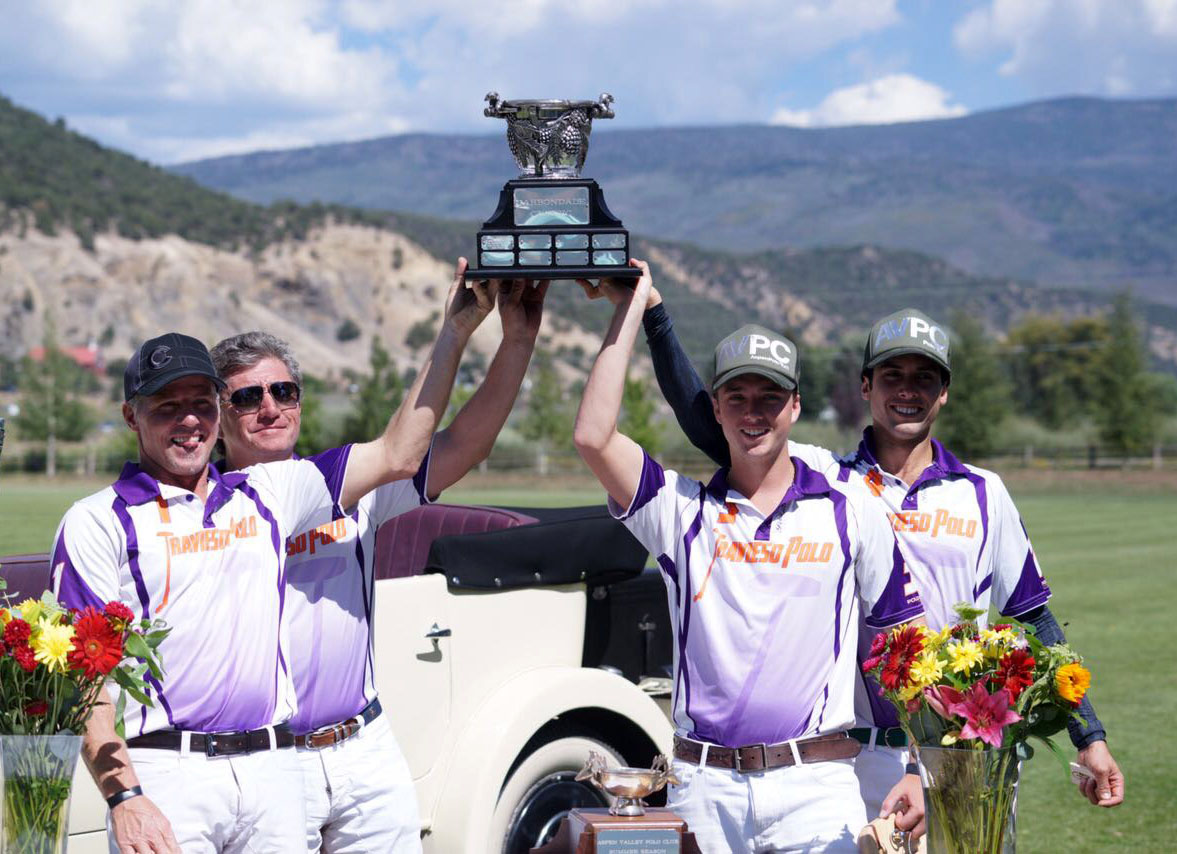 Travieso teammates Mike Azzaro, Teo Calle, Tony Calle and Carlitos Gracida hoist the Carbondale Classic trophy.