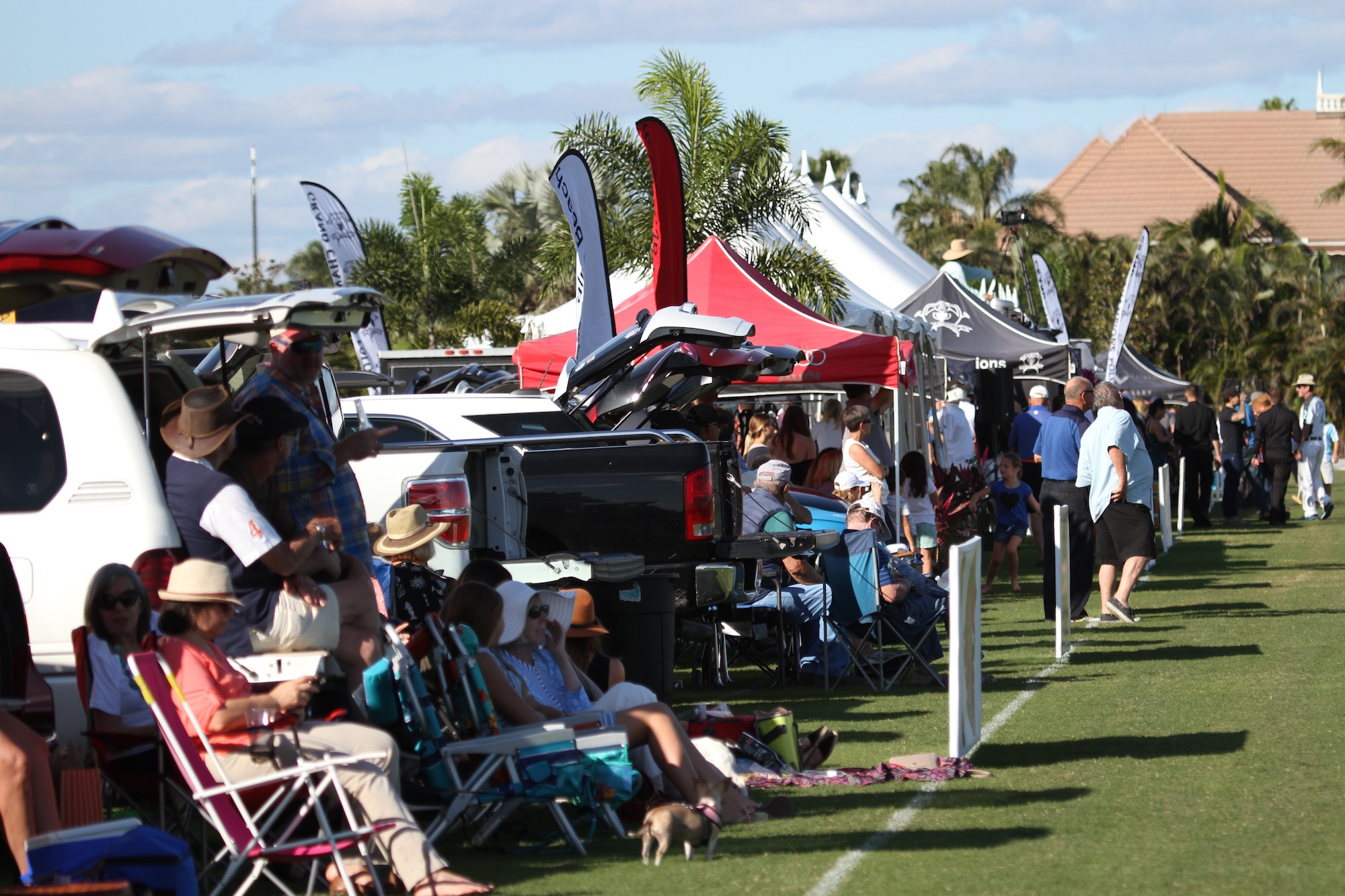 A packed crowd of tailgaters enjoyi.SA.JPG