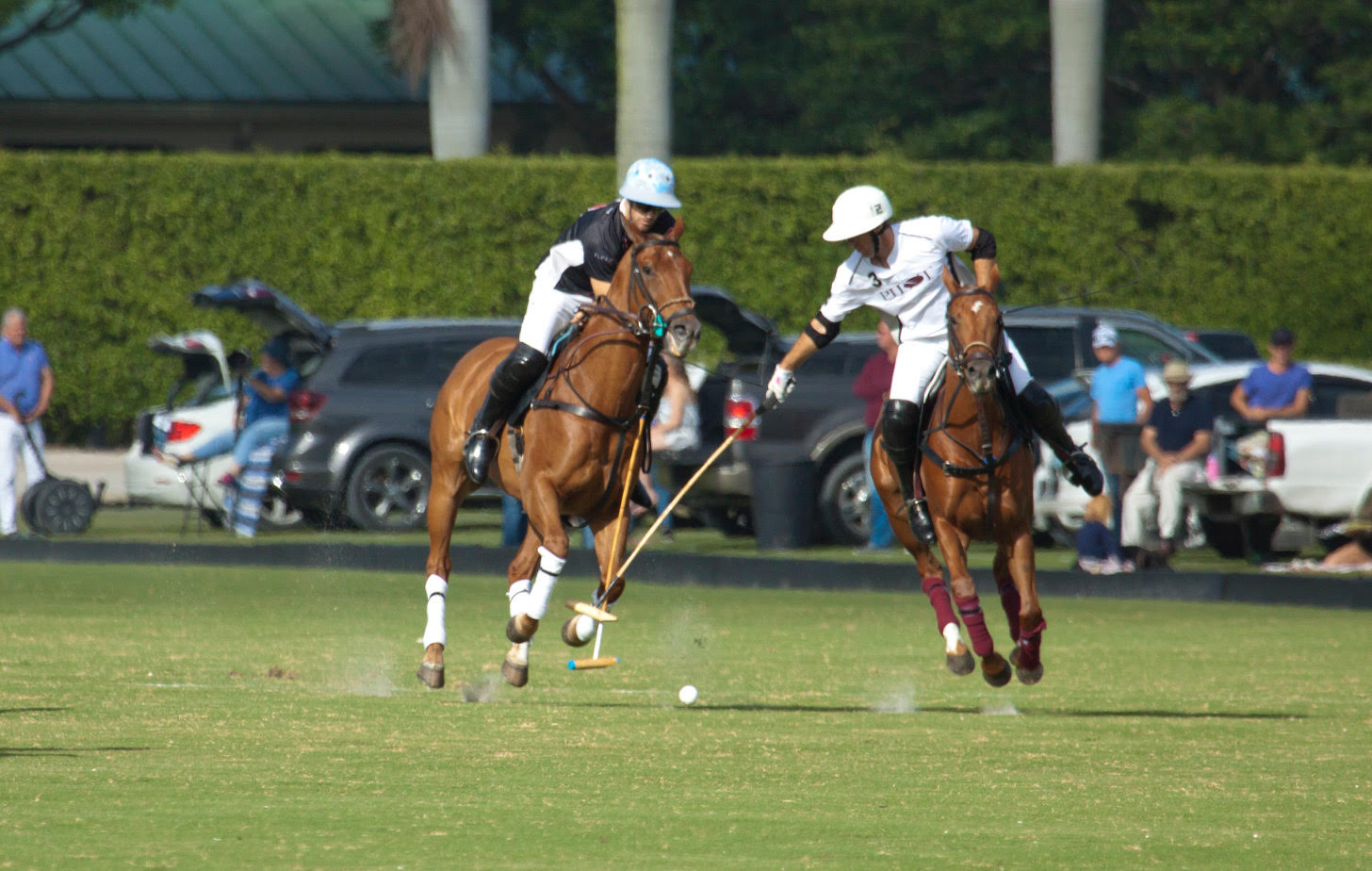 Brothers Nico Pieres of Audi and Gonzalito Pieres of Pilot battle for the ball.