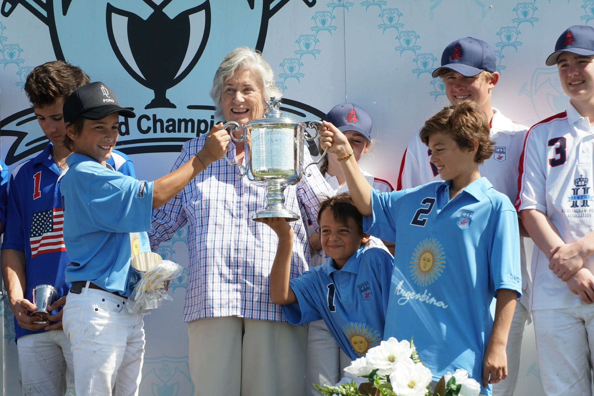 Two-time PTF International Cup champion Argentina with awards presenter Gil Johnston. Photo by ChukkerTV