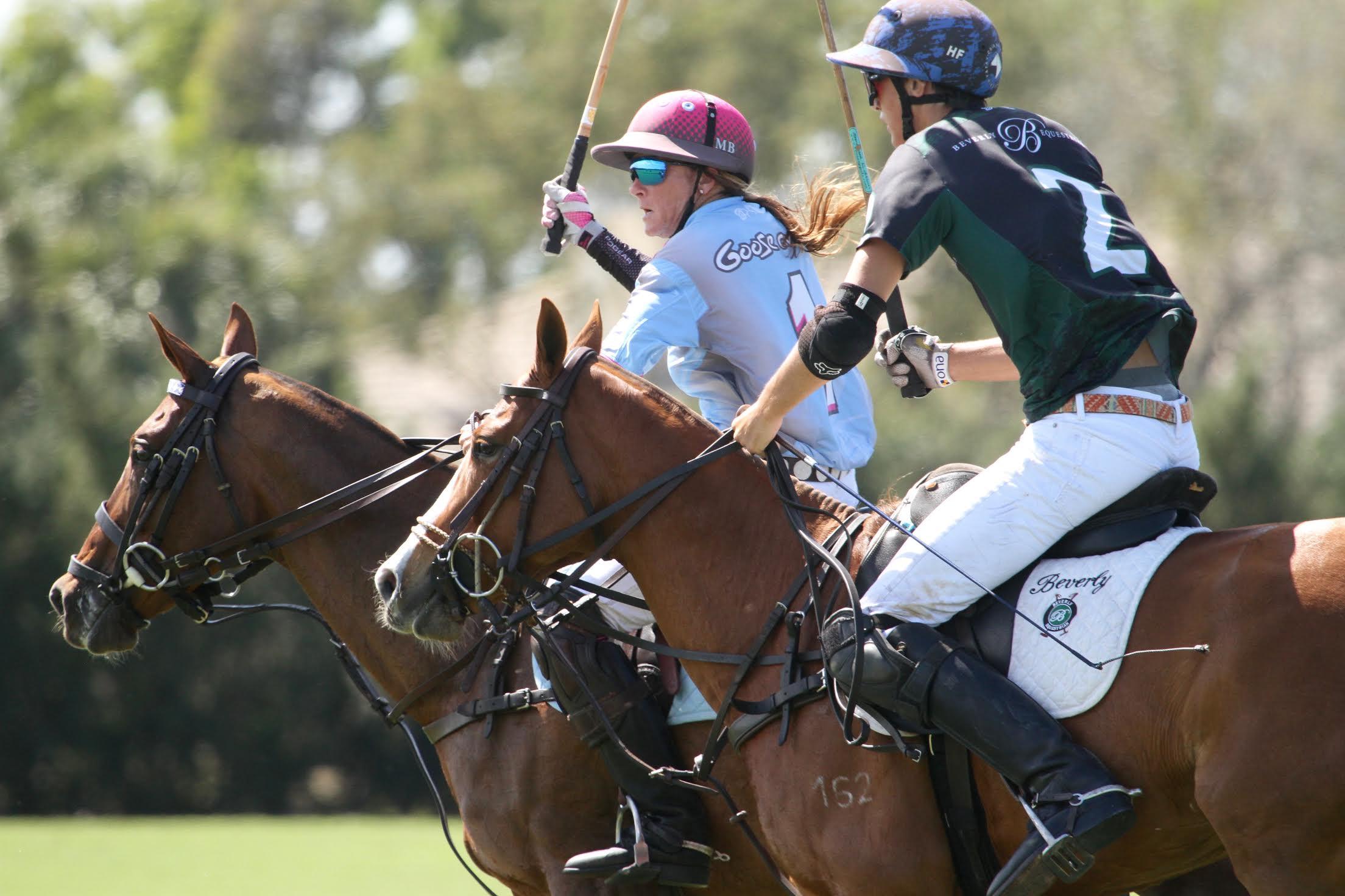 Hilario Figueras of Beverly Equestrian defends Maureen Brennan of Goose Creek/GSA.
