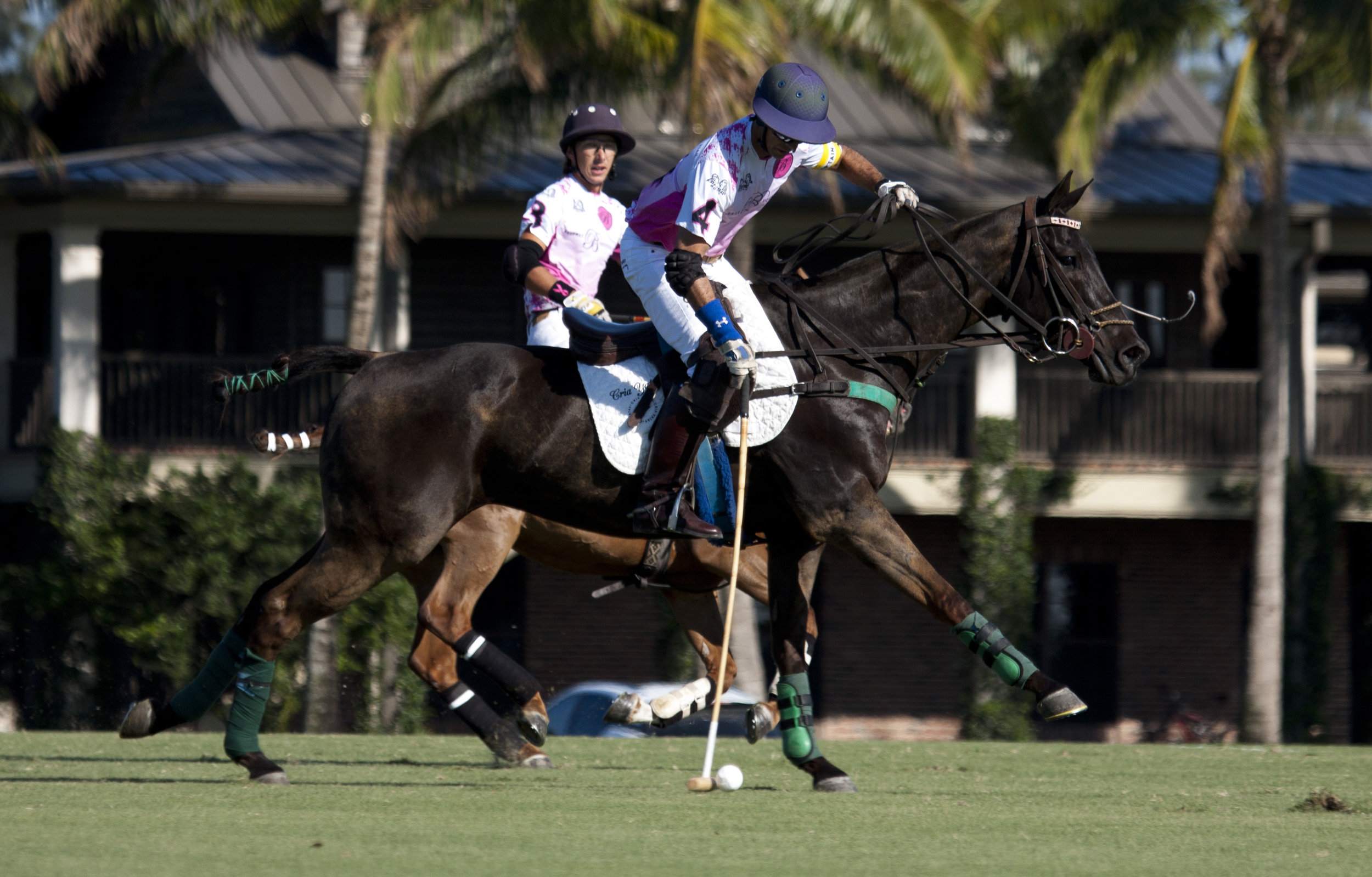Beverly Equestrian teammates Carlucho Arellano and Tolito Ocampo work together downfield.
