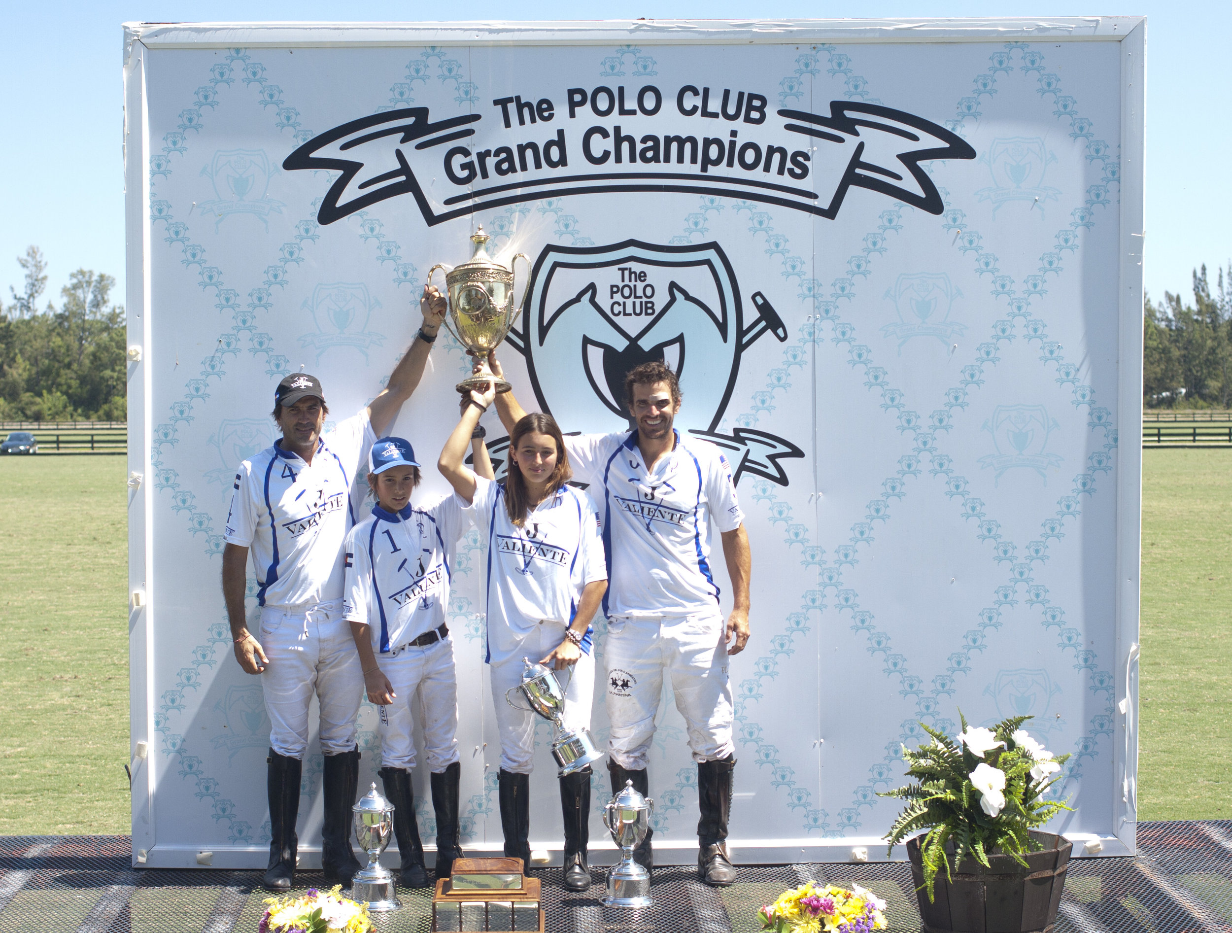 Sterling Cup champion Valiente players Adolfo, Poroto and Mia Cambiaso and Magoo Laprida.