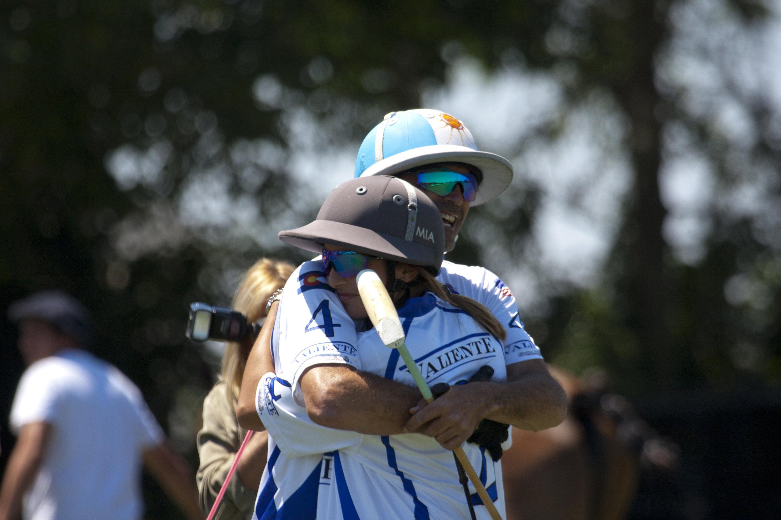 Adolfo Cambiaso hugs his daughter Mia.JPG